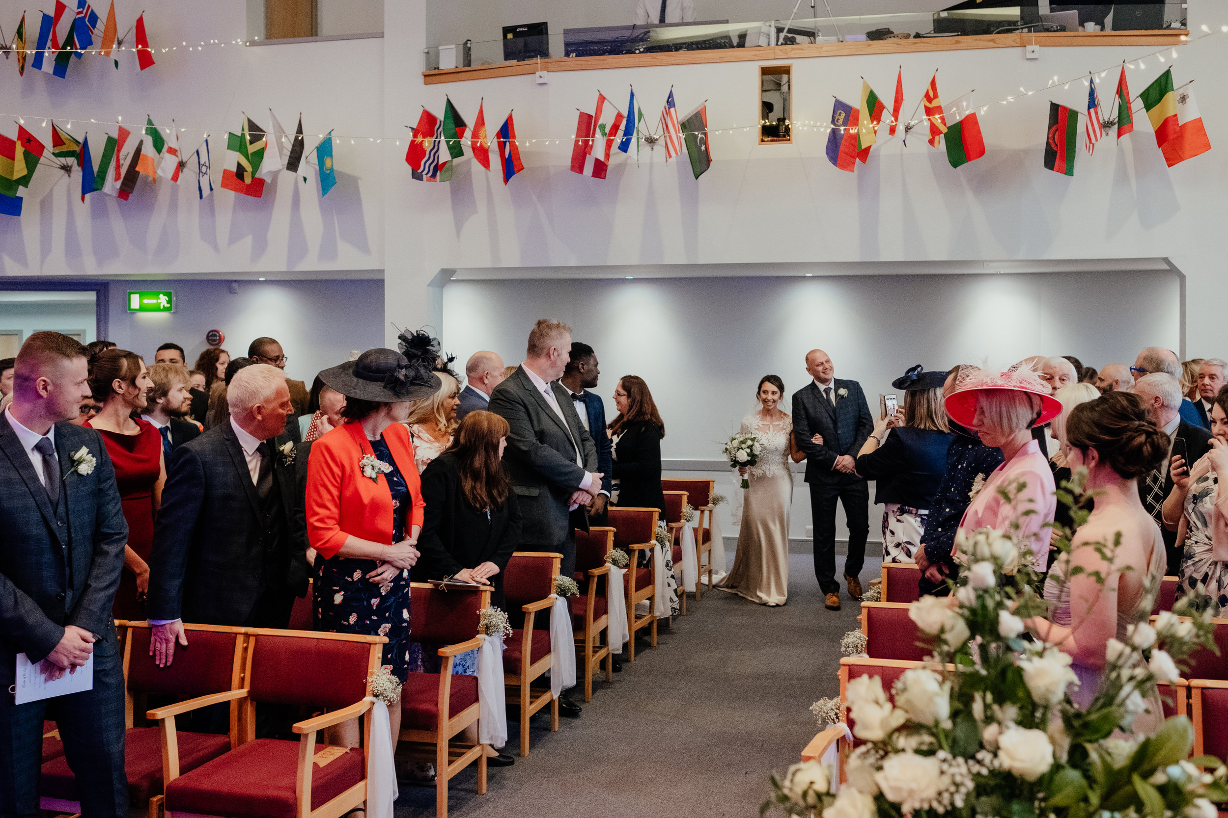 Bride walks down the aisle with Father of the Bride and Groom waits for her at the altar