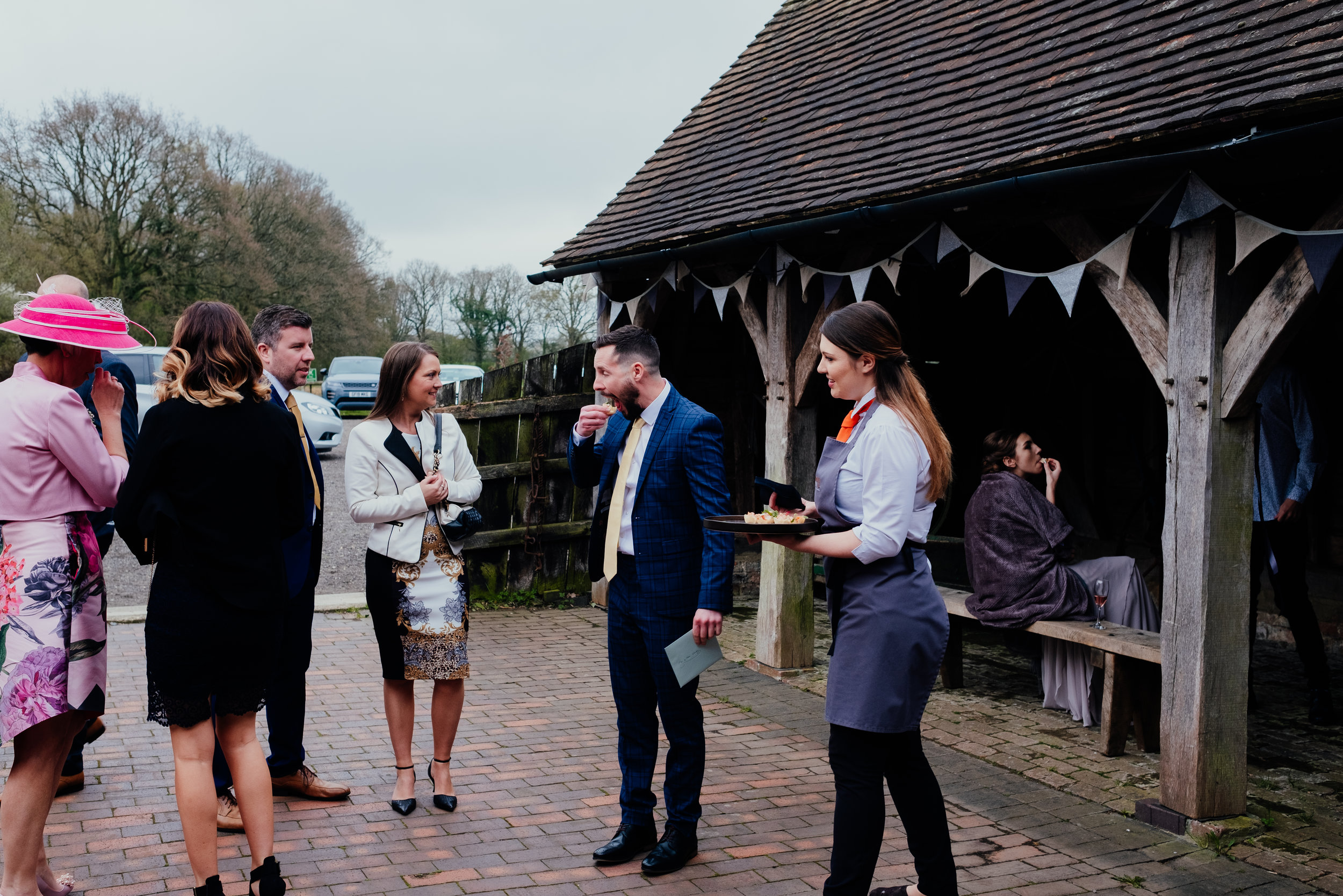 Wedding guests eat canapés at Gildings Barn