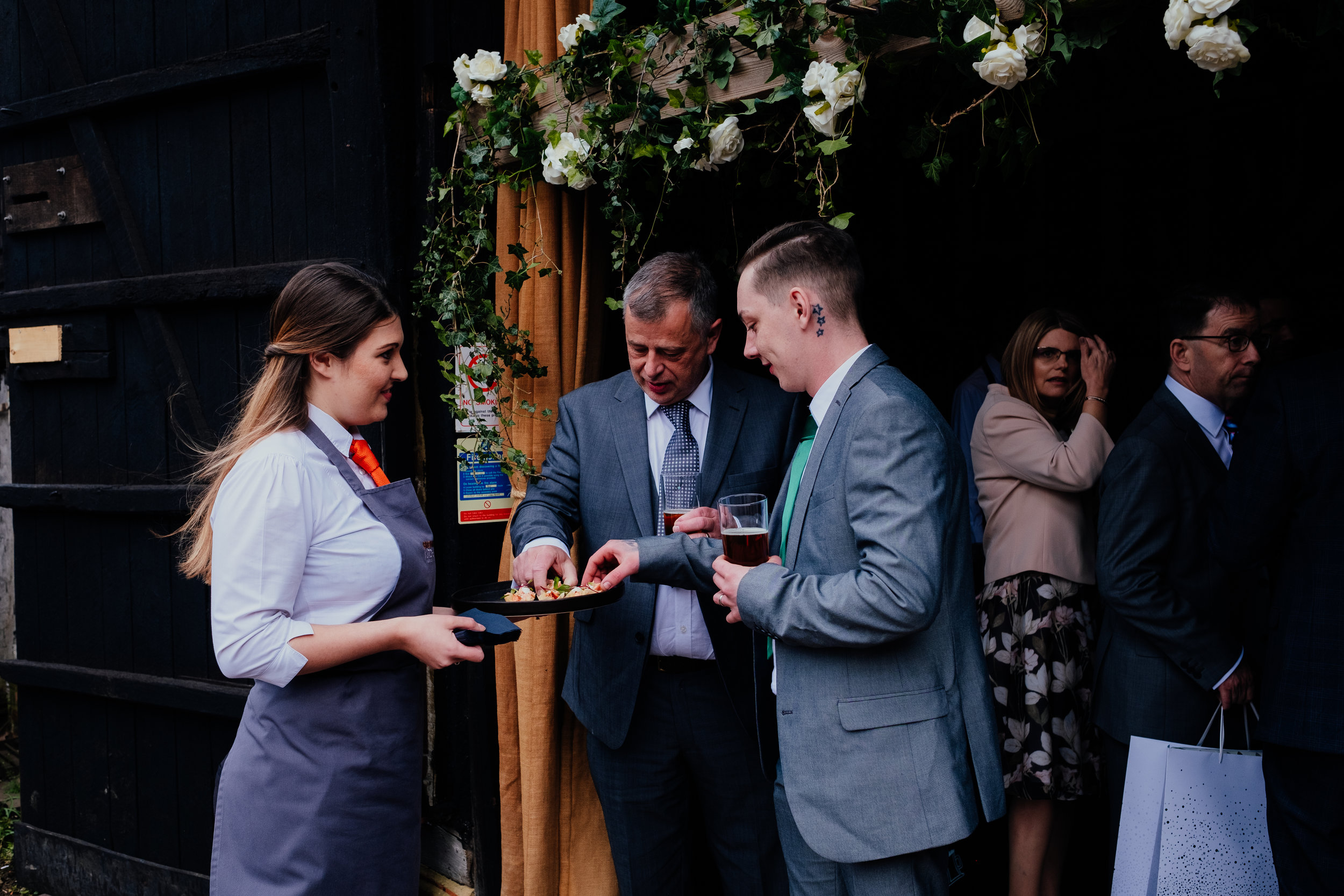 Wedding guests eating canapés at Gildings Barn