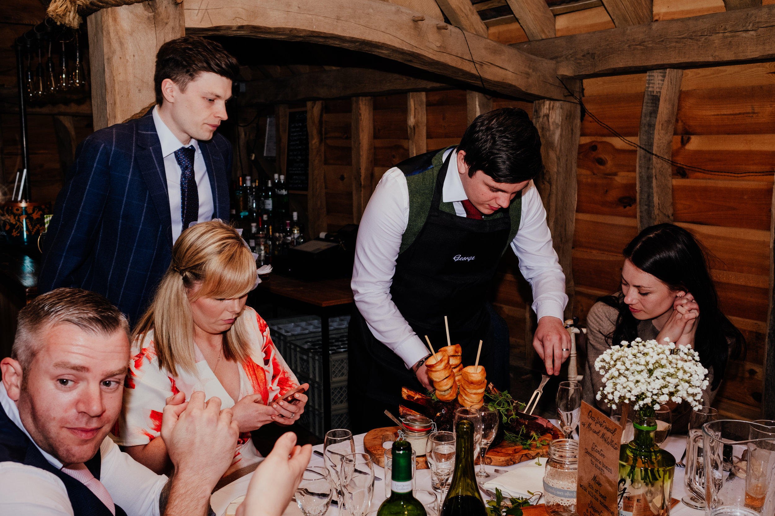 Guests eating a carvery for the wedding breakfast