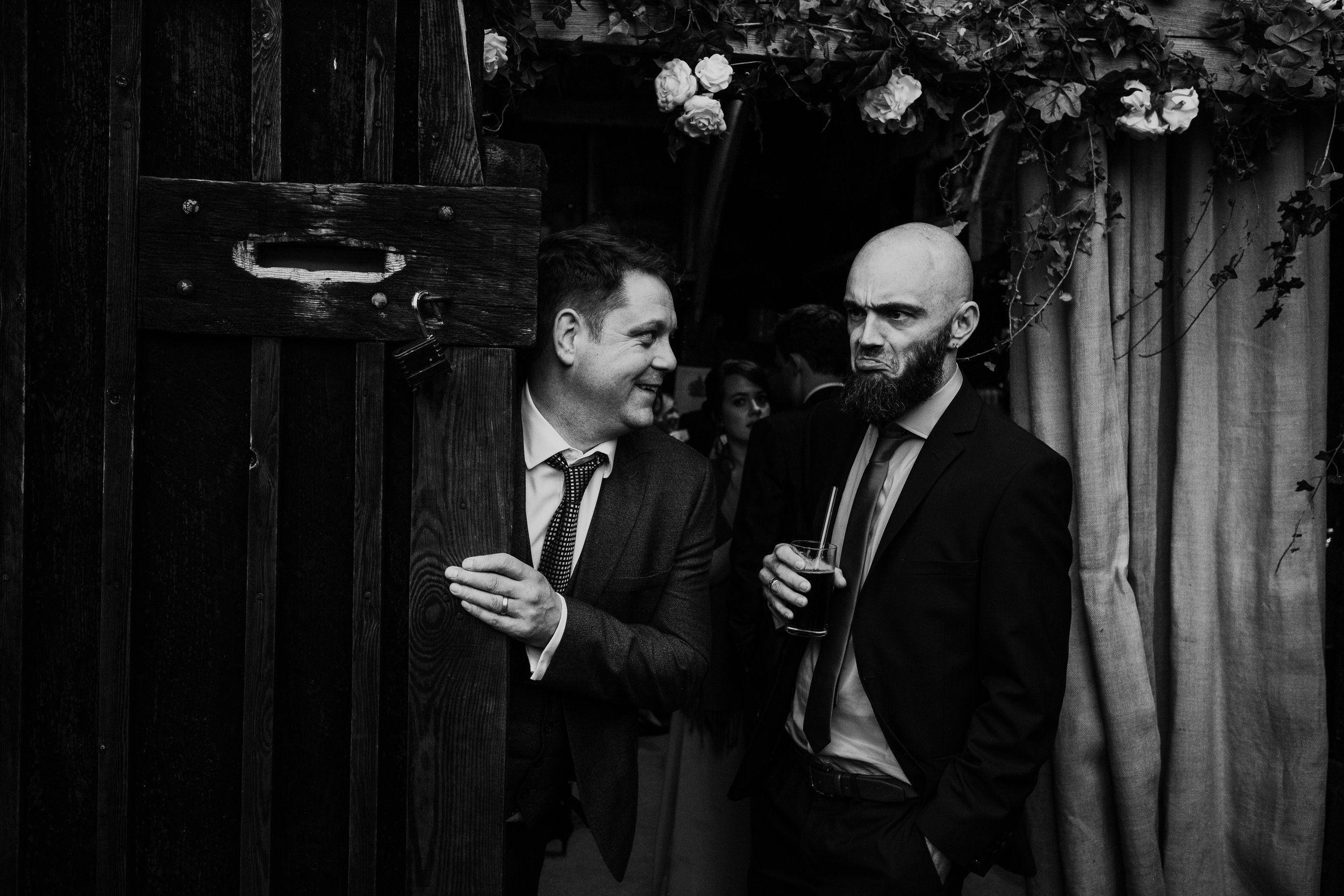 Guests laughing and pulling faces at wedding