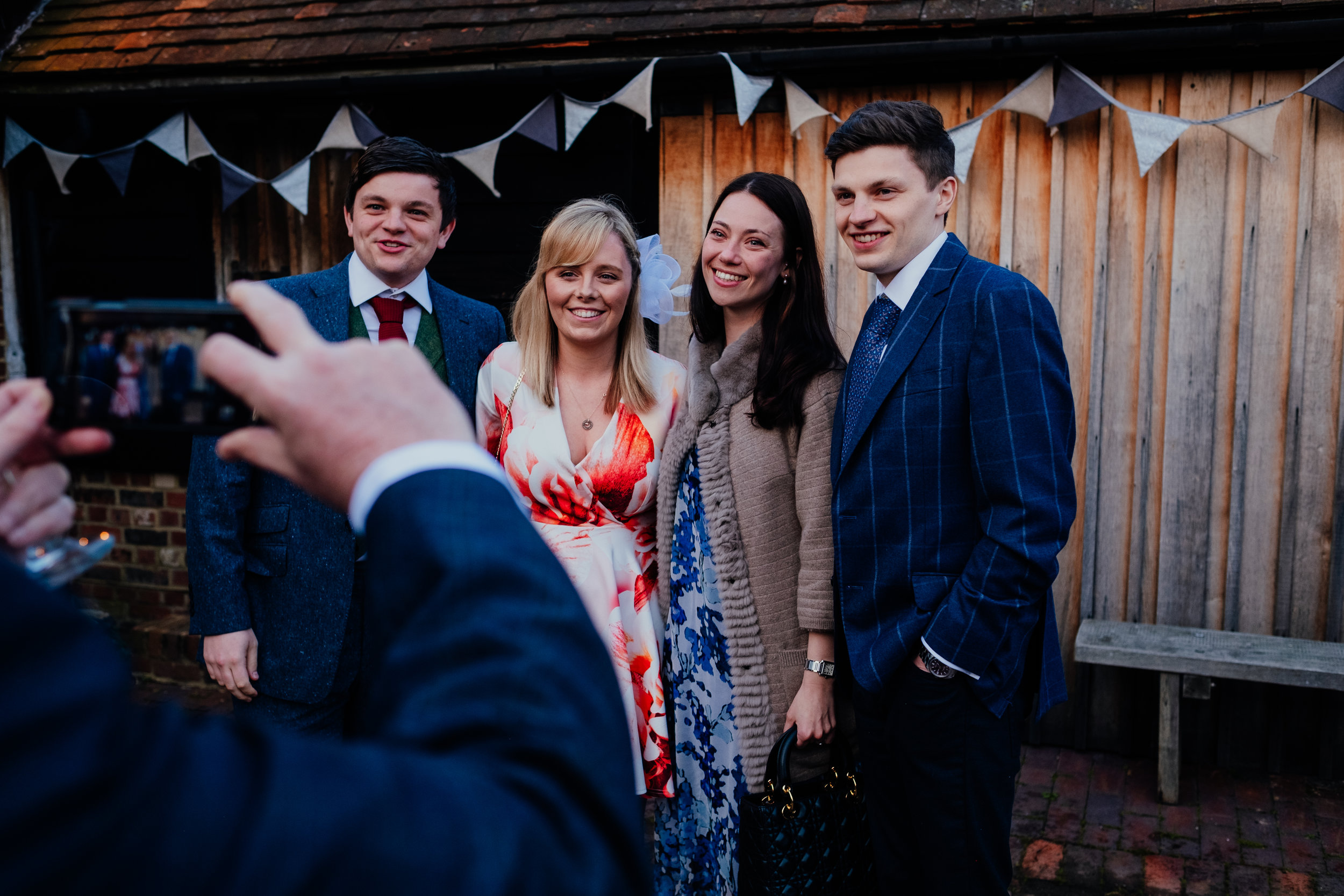 Wedding guest takes photo of other wedding guests