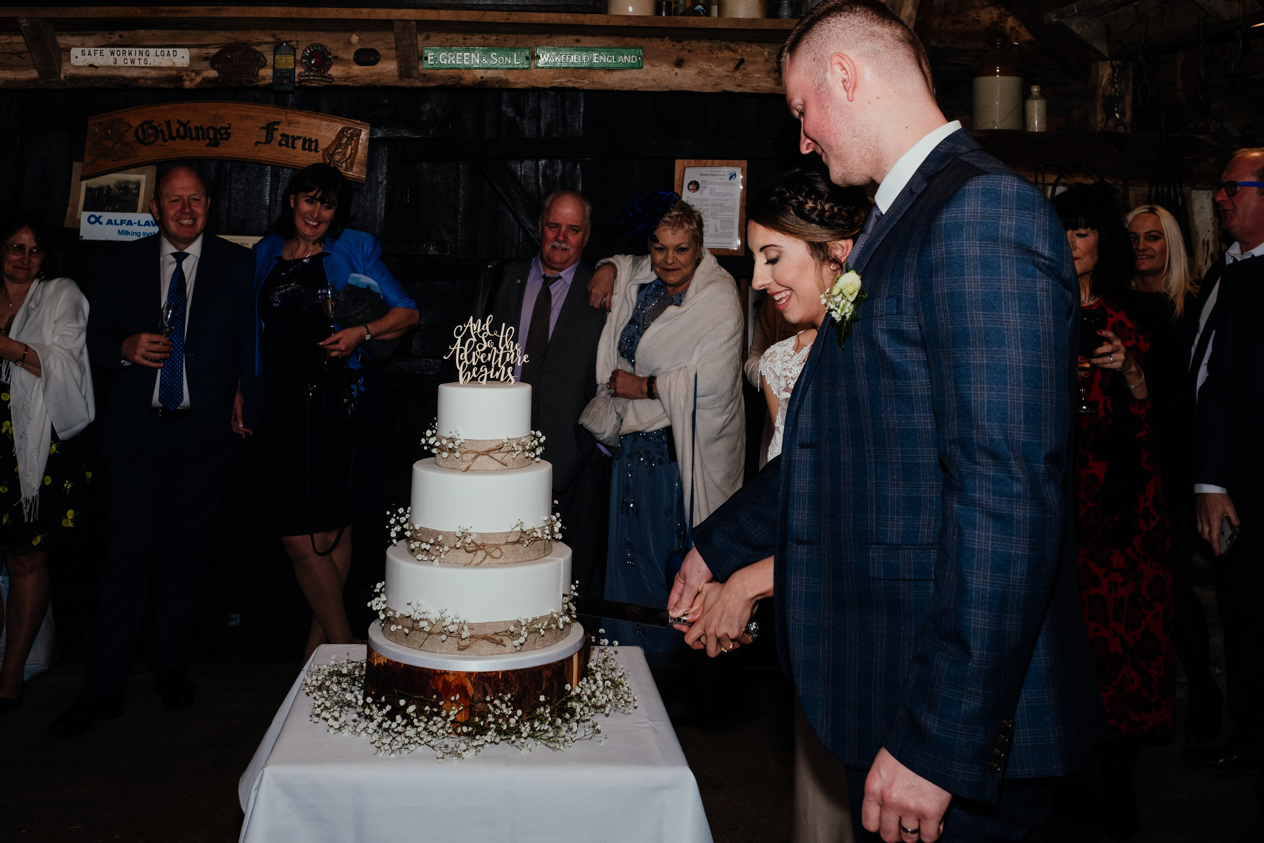 Bride and Groom cut wedding cake at Gildings Barn