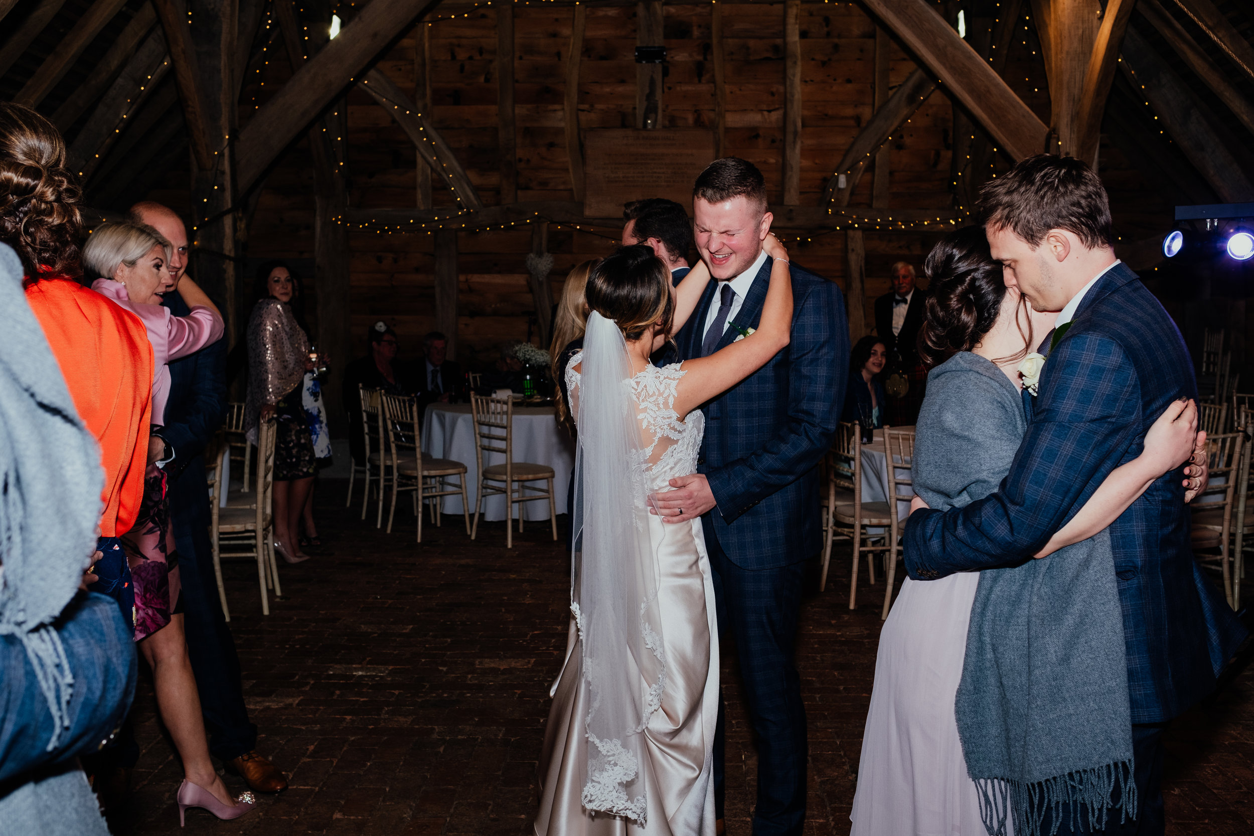 Wedding guests and bride and groom dancing at Gildings Barn