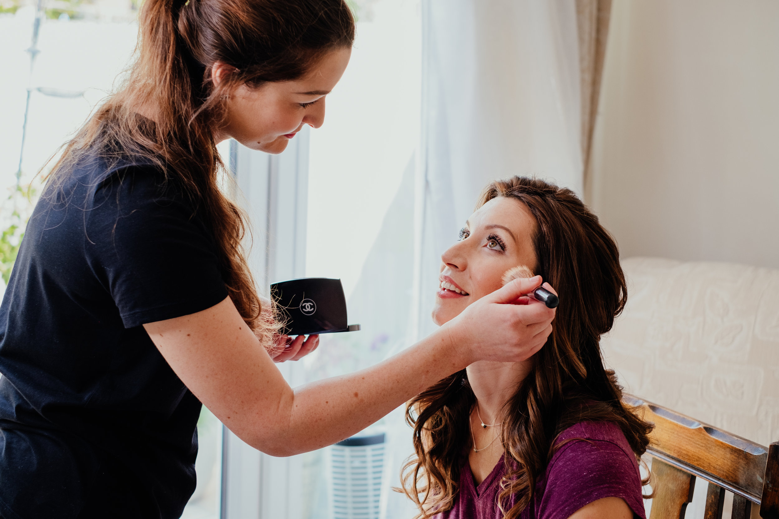 Bride having make up applied on the morning of her wedding