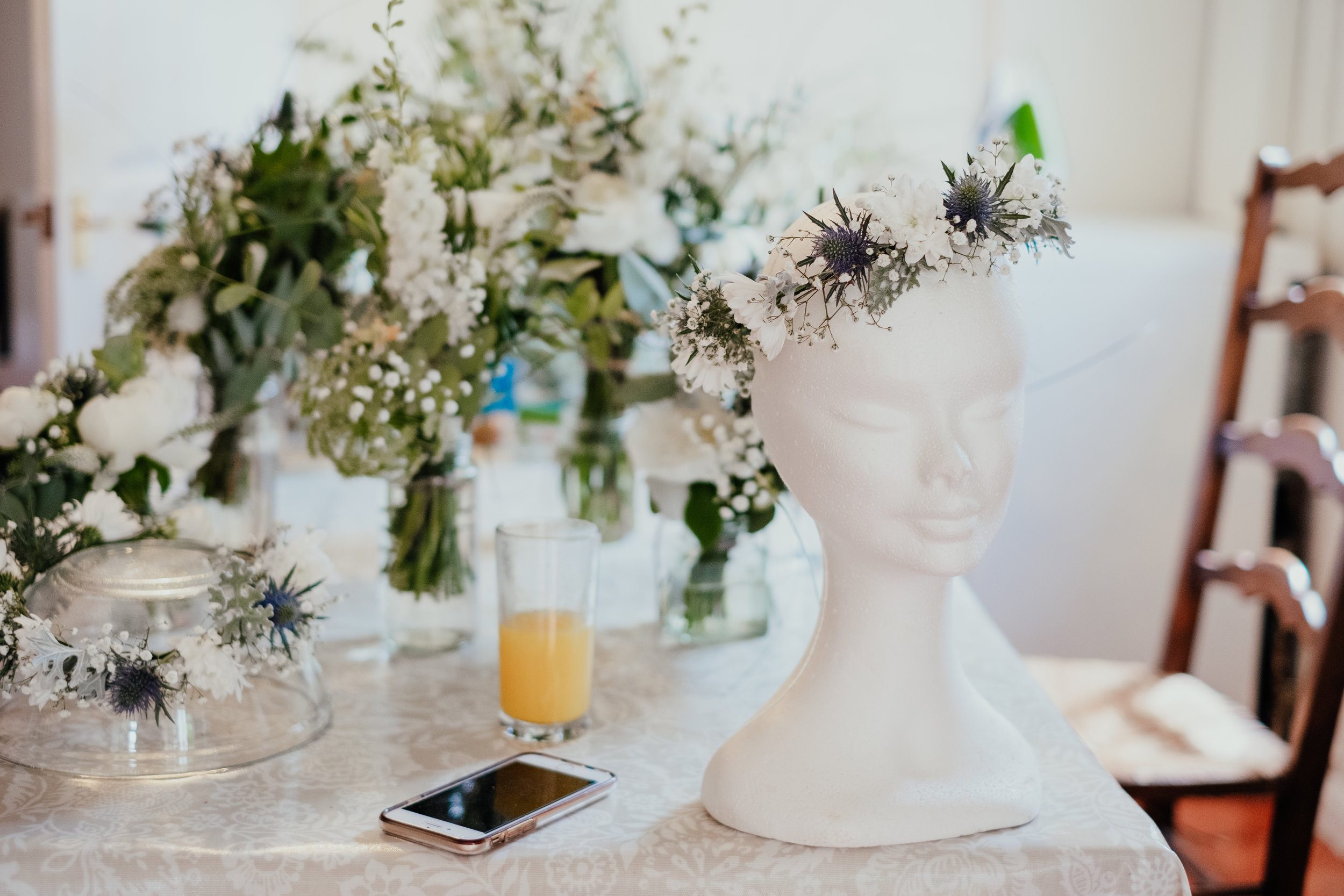Flower crown and flowers on mannequin head