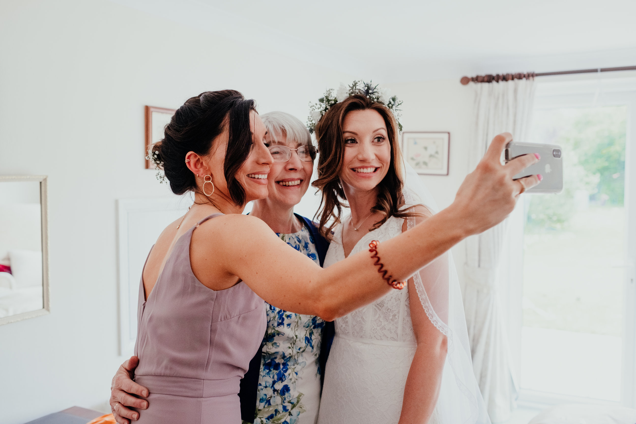 Bride, Maid of Honour and Mother of the Bride take a selfie