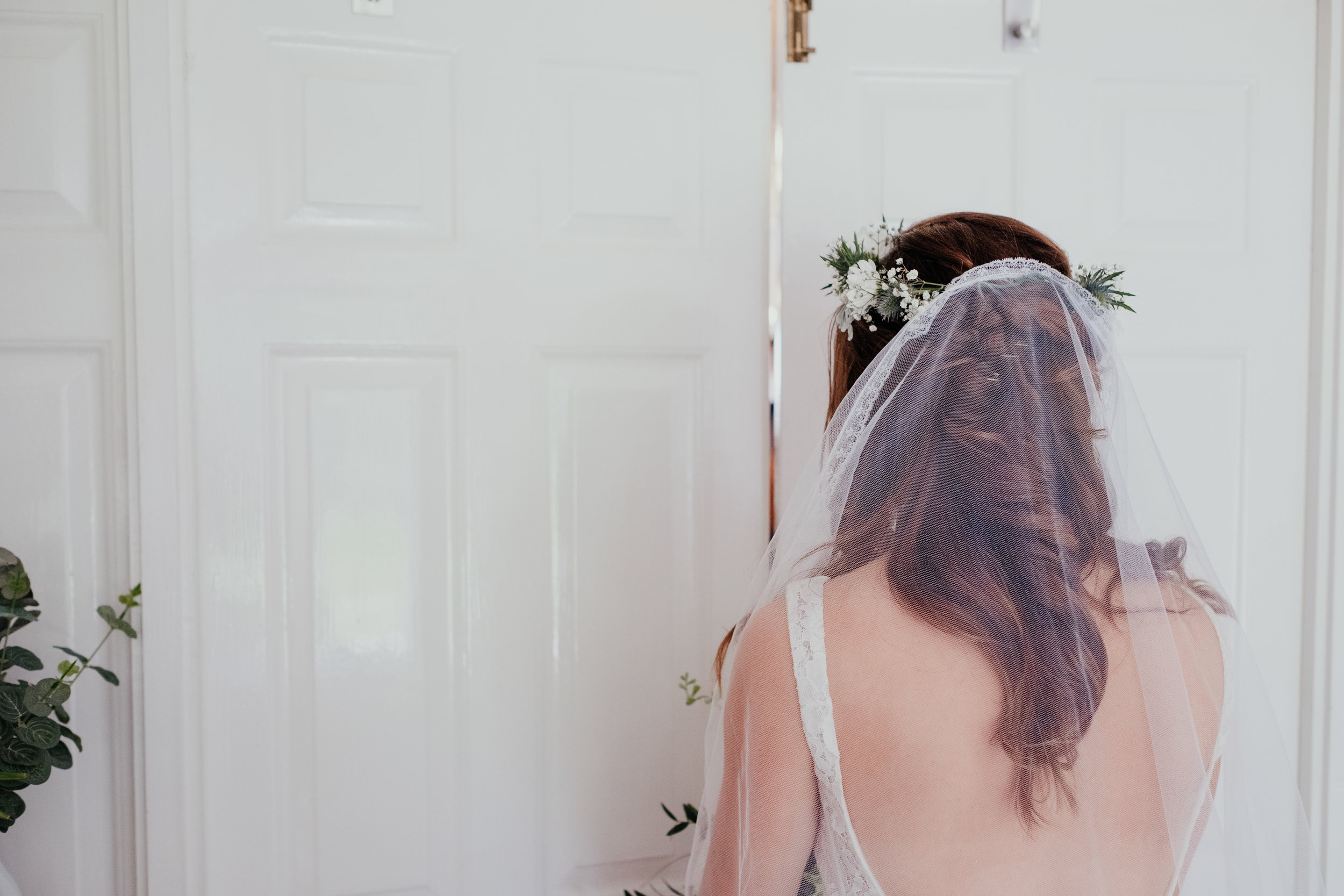 Bride pushes open door for big reveal to family