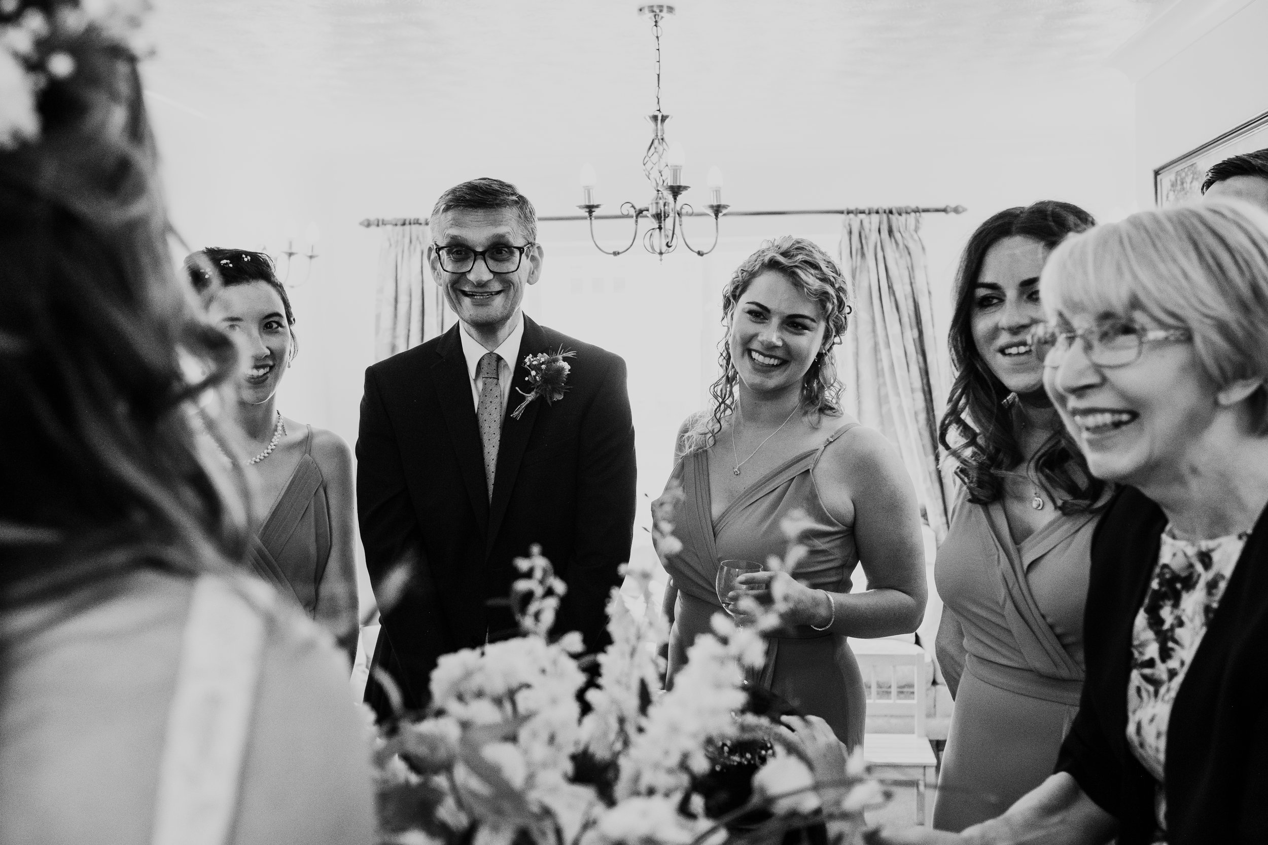 Bride first look with family and bridesmaids