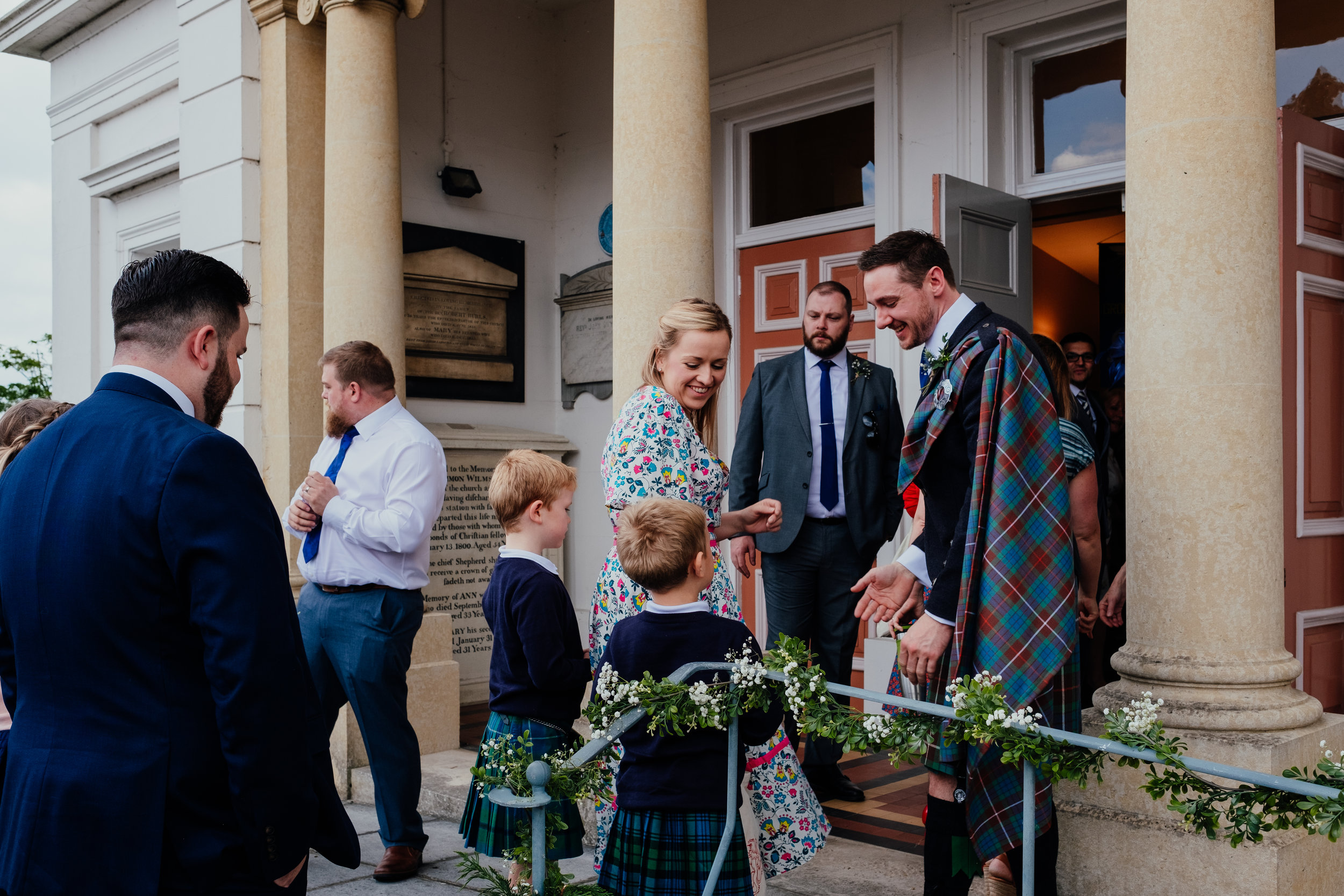 Groom greets guests at the church