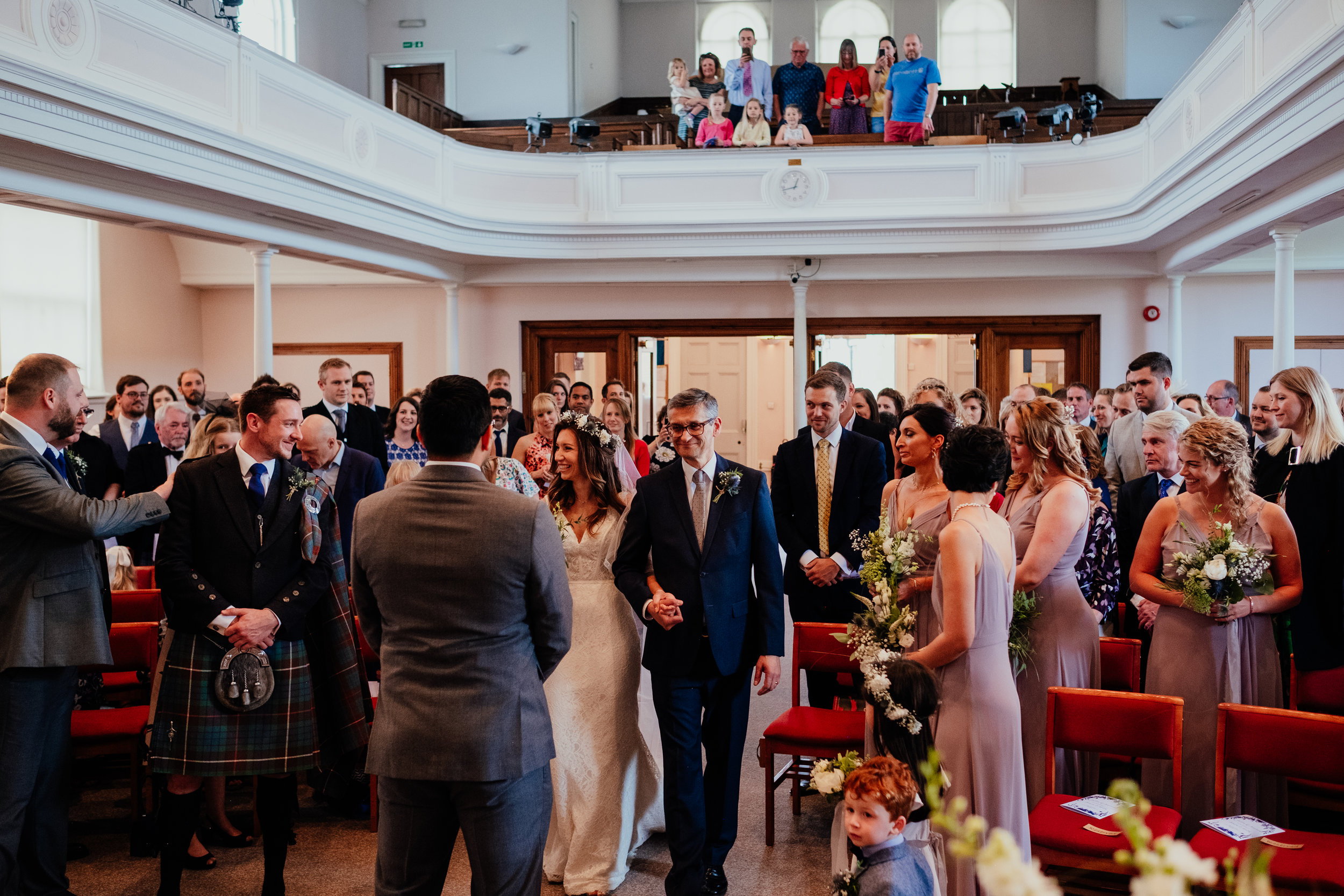Groom sees his bride for the first time as she walks up the aisle with her Father