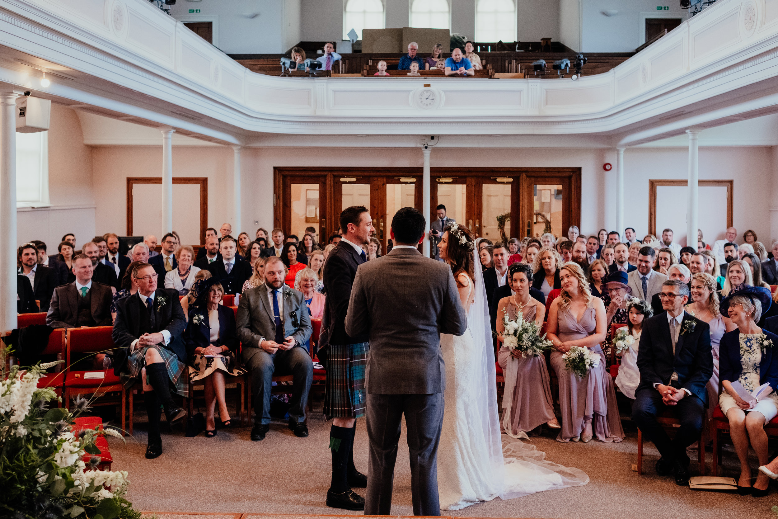 Bride and Groom exchange vows in front of friends and family at United reformed Church in Maldon Essex
