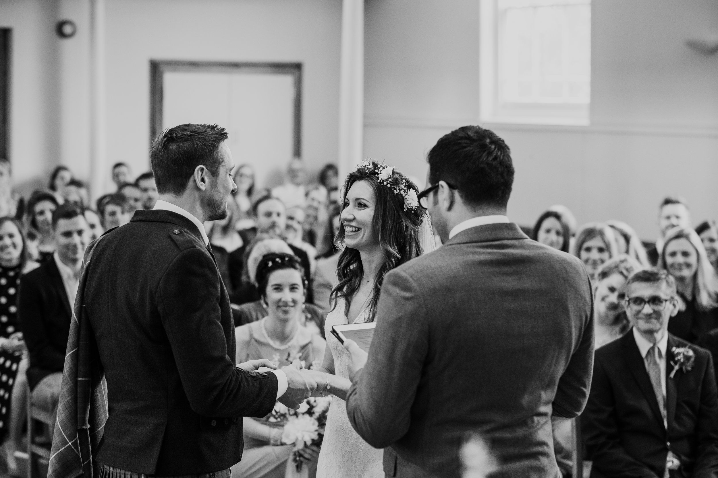 Bride and Groom exchange vows at United reformed Church Maldon Essex wedding photography