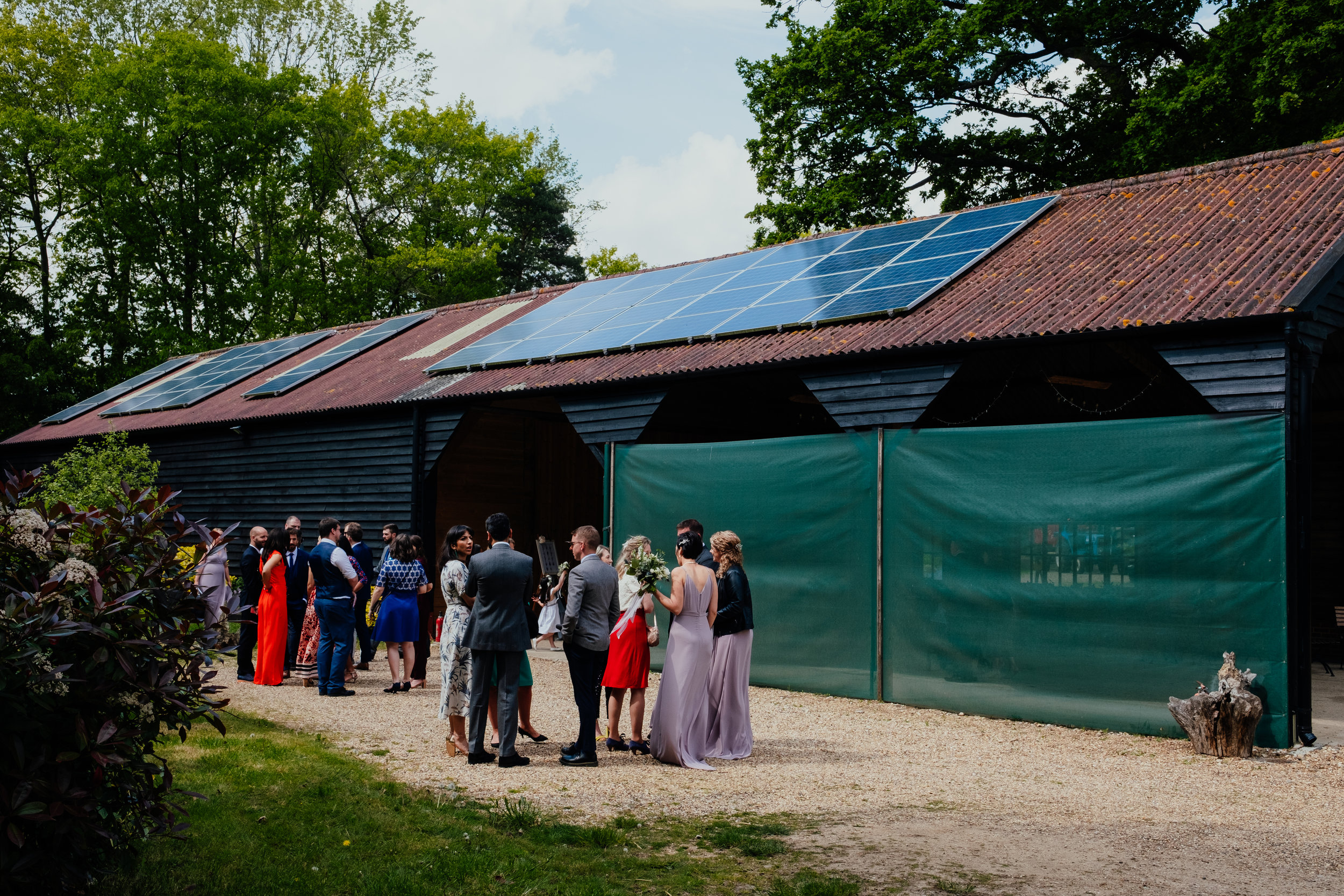 Guests stood outside Captains Wood Barn wedding