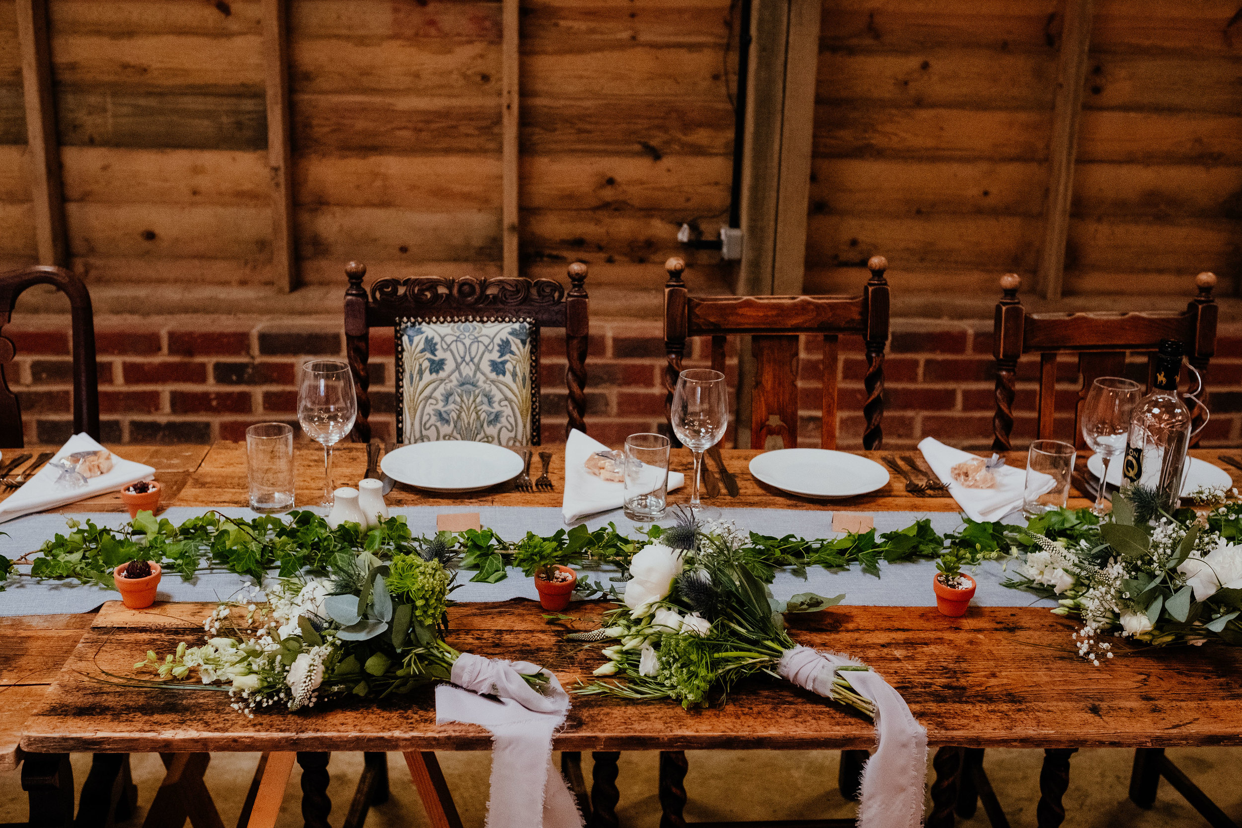 Rustic wedding at Captains Wood Barn wedding photography table setting