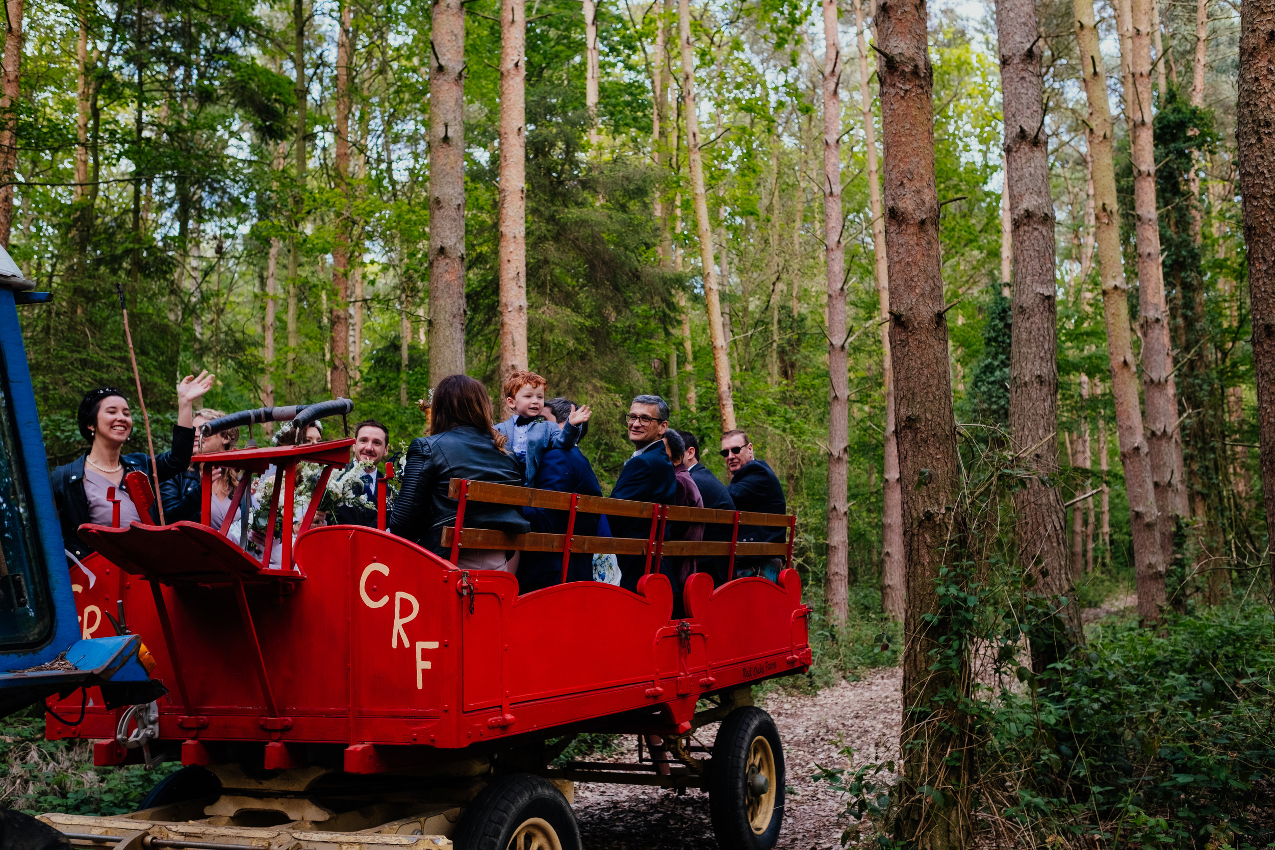 Captains Wood Barn Wedding Photography wedding tractor carrying wedding party