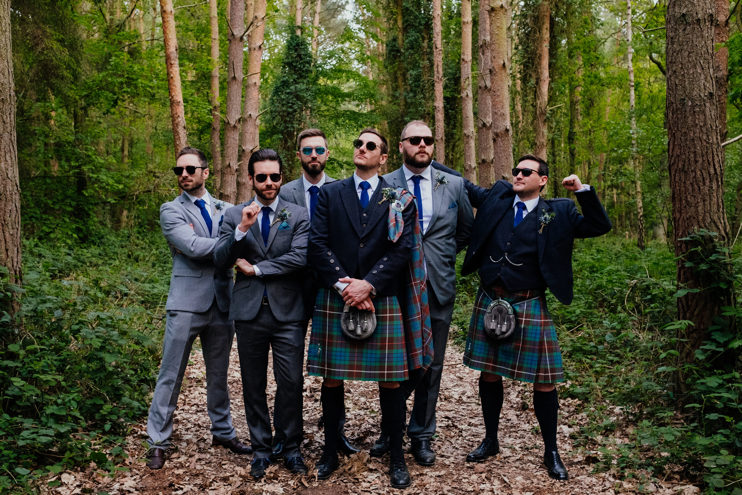 Groom and Groomsmen wearing sunglasses at Captains Wood Barn wedding