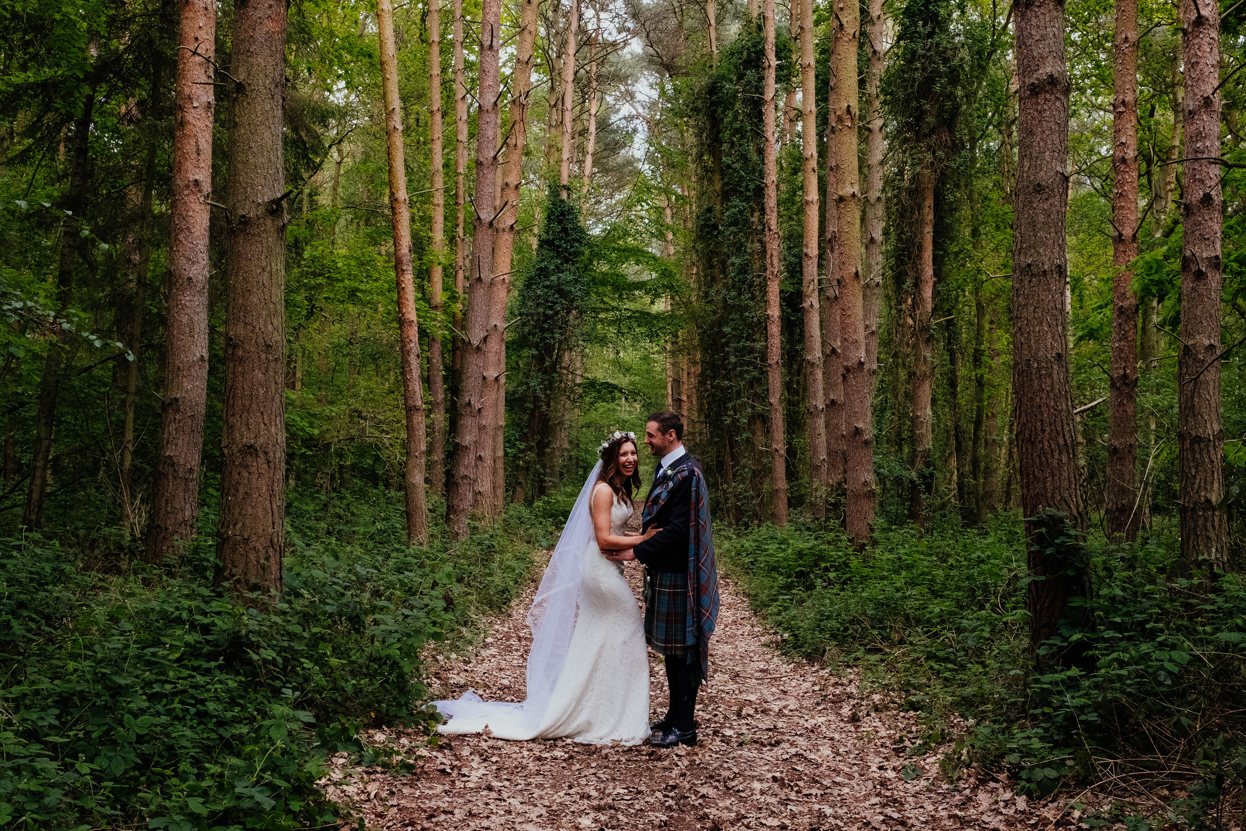 bride and groom woodland portrait at Captains Wood Barn wedding