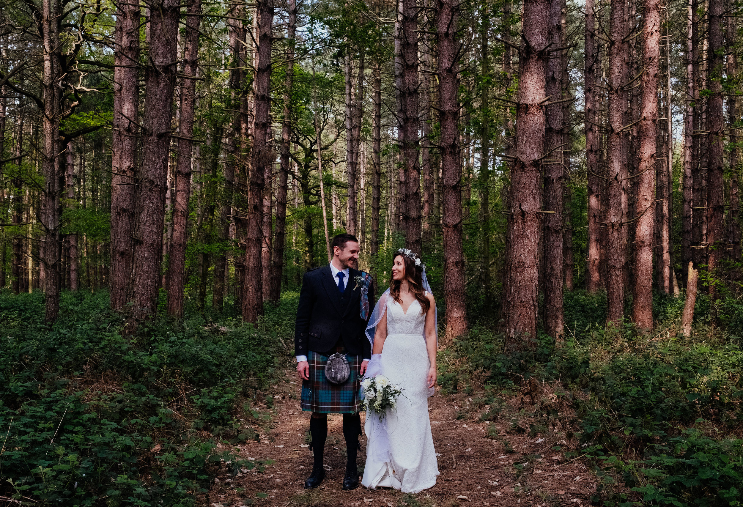 Bride and Groom wedding portrait in the woodlands at Captains Wood Barn wedding photography