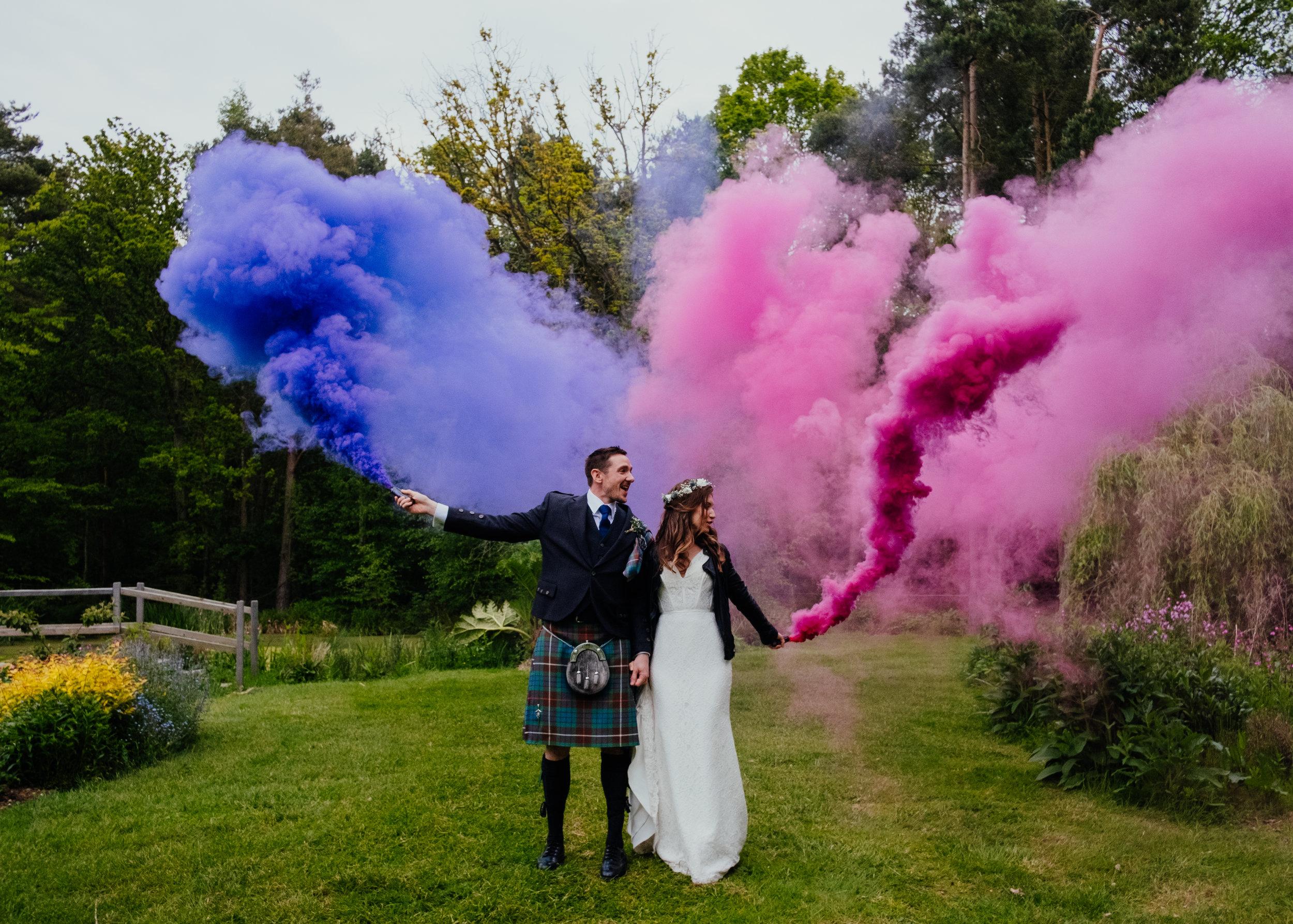 Captains Wood Barn wedding photography coloured smoke grenades