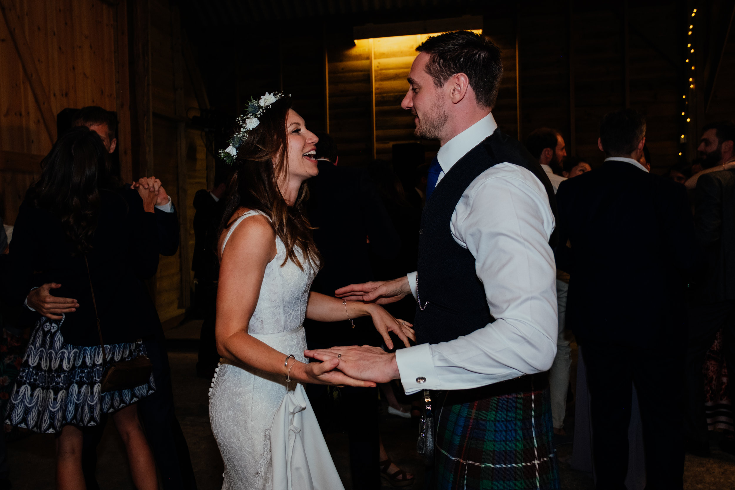 Bride and Groom dancing at Captains Wood Barn wedding