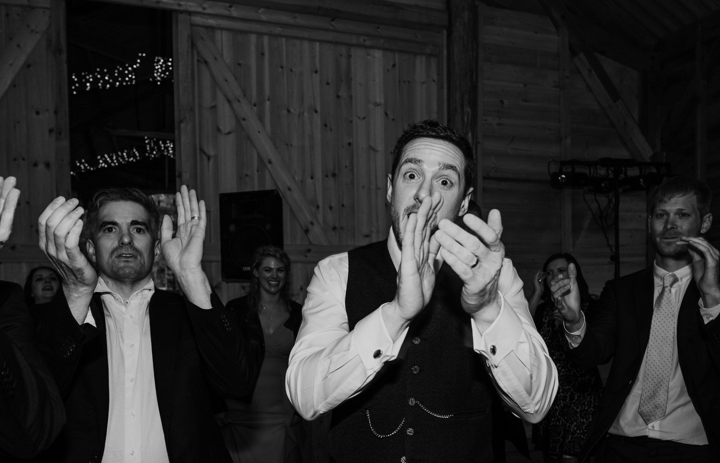Groom dances Ceilidh wedding dance at Captains Wood Barn