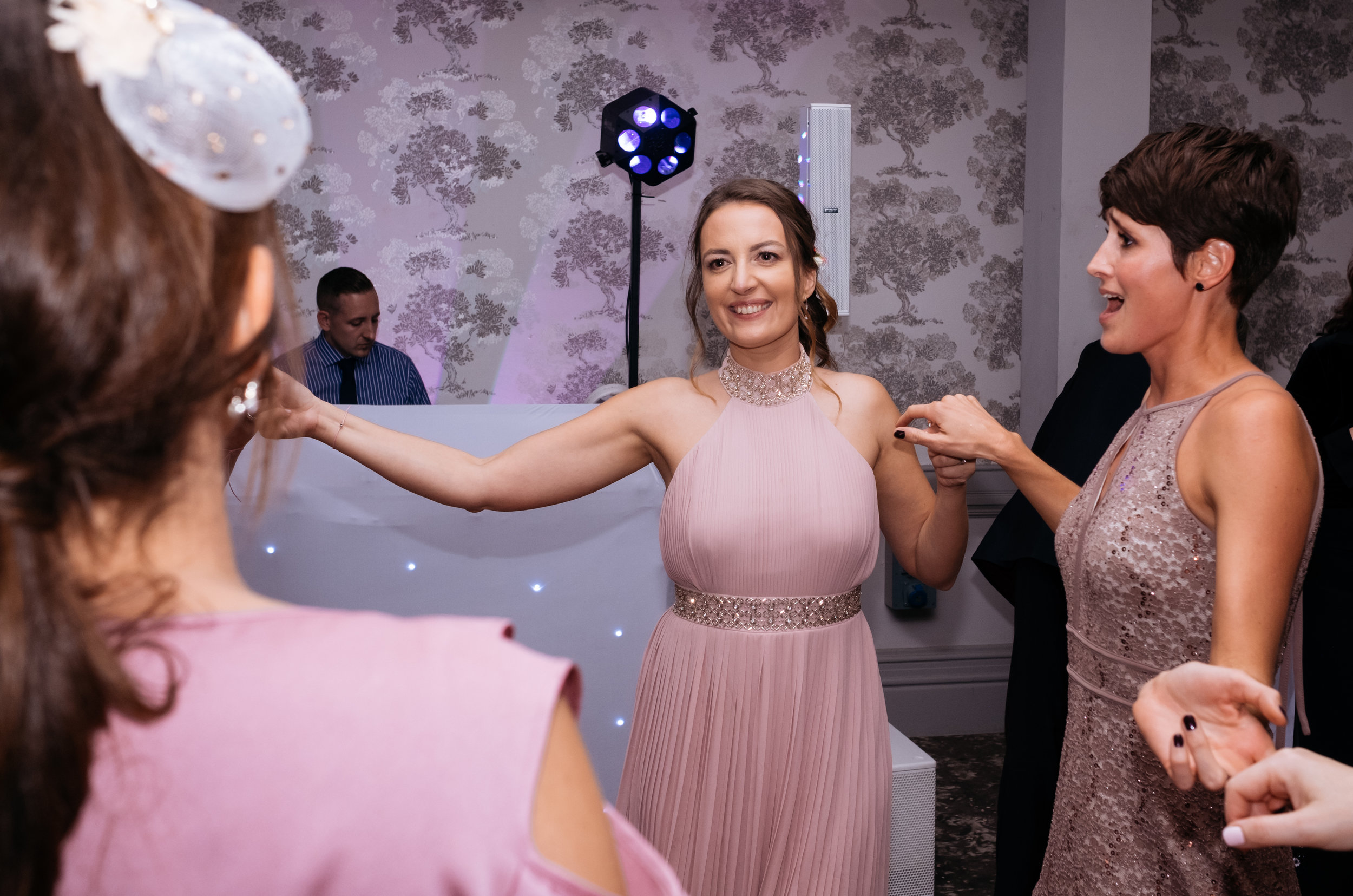 Bridesmaids dancing at wedding