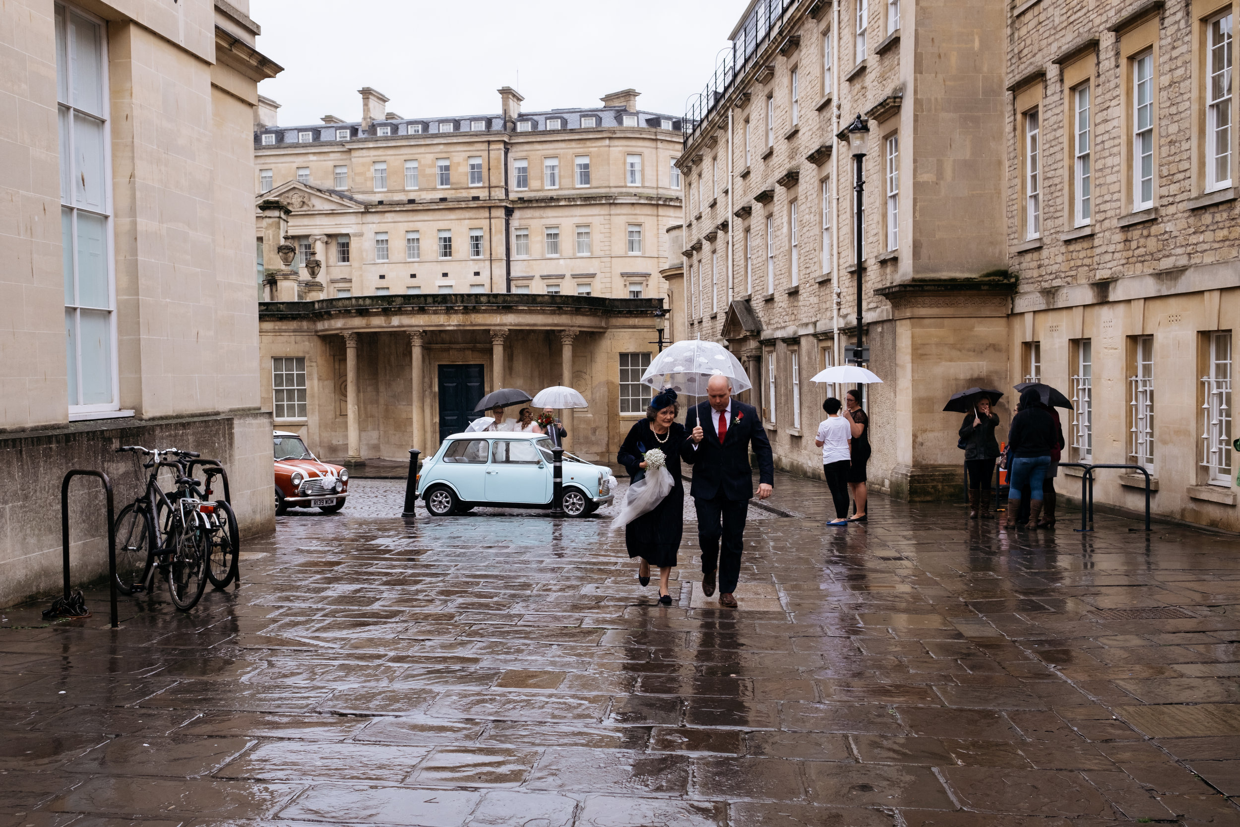 Mother of the bride and brother walk along to the Little Theatre wedding in Bath