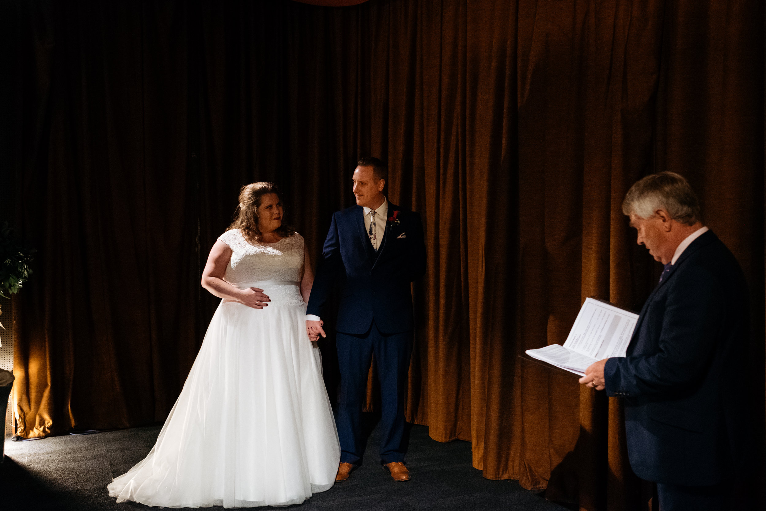Bride and Groom stand with celebrant on the stage at the Little Theatre in Bath