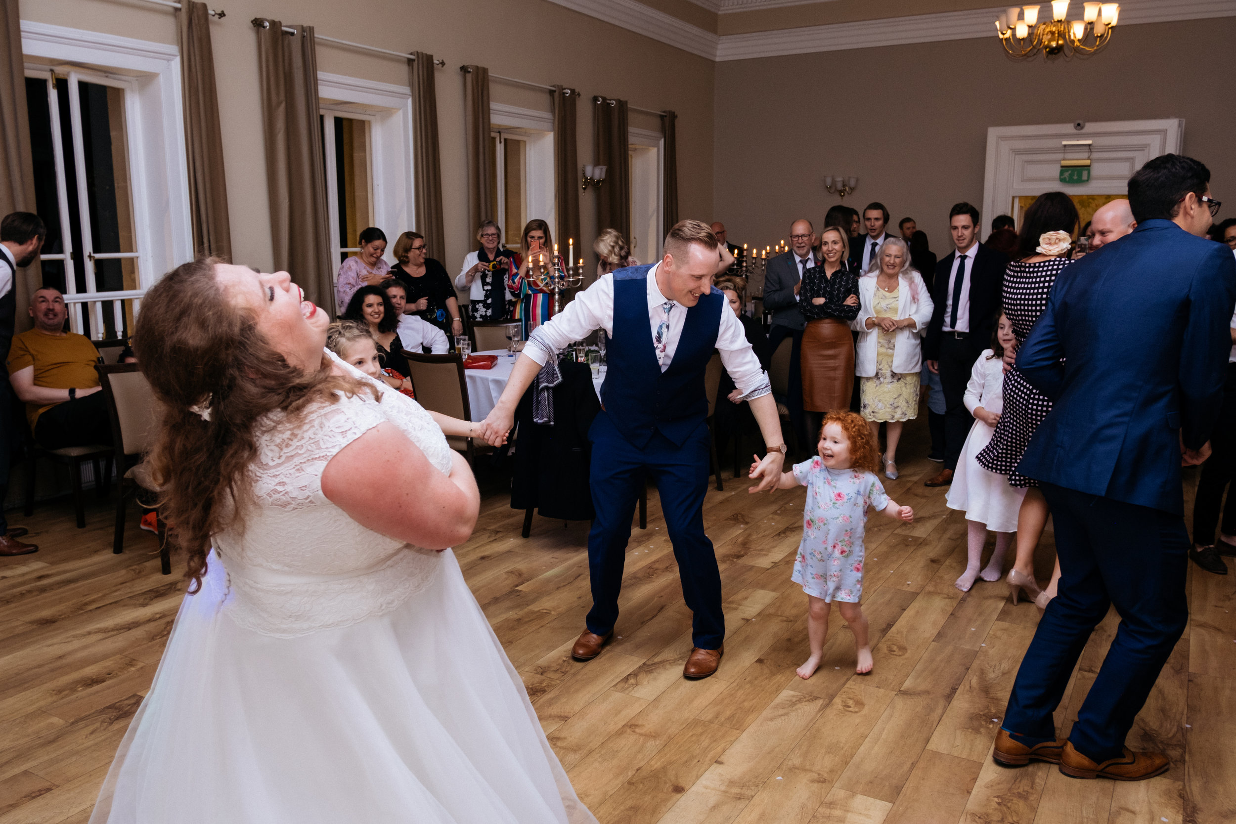 Bride laughing during first dance at Bath Function Rooms wedding