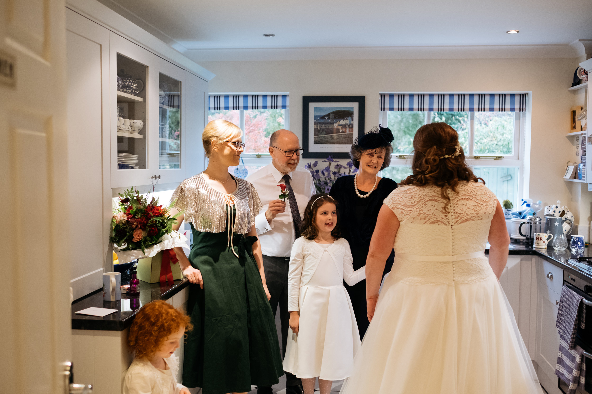 Family react to bride in wedding dress