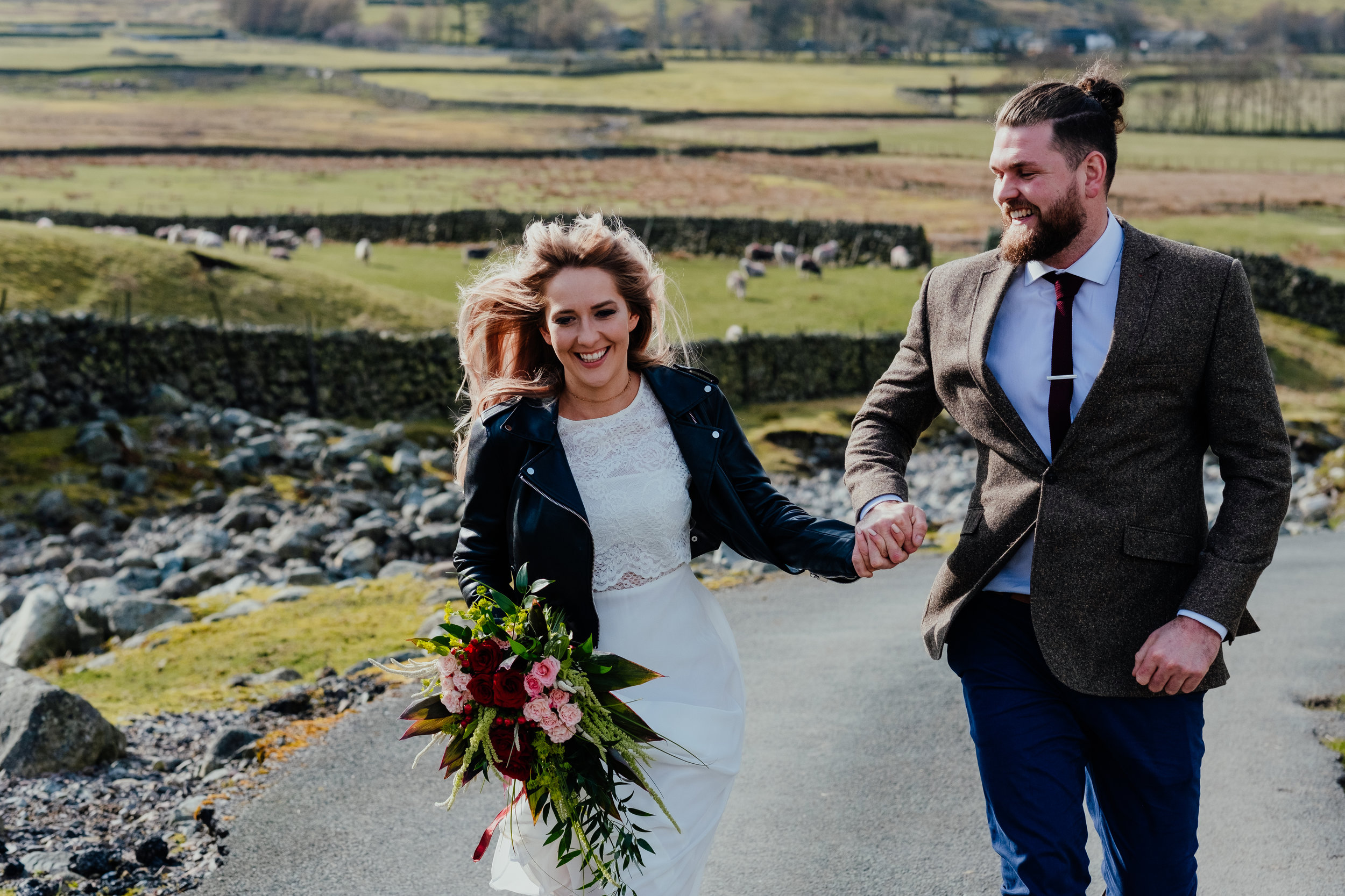 Lake District Elopement bride and groom running and smiling