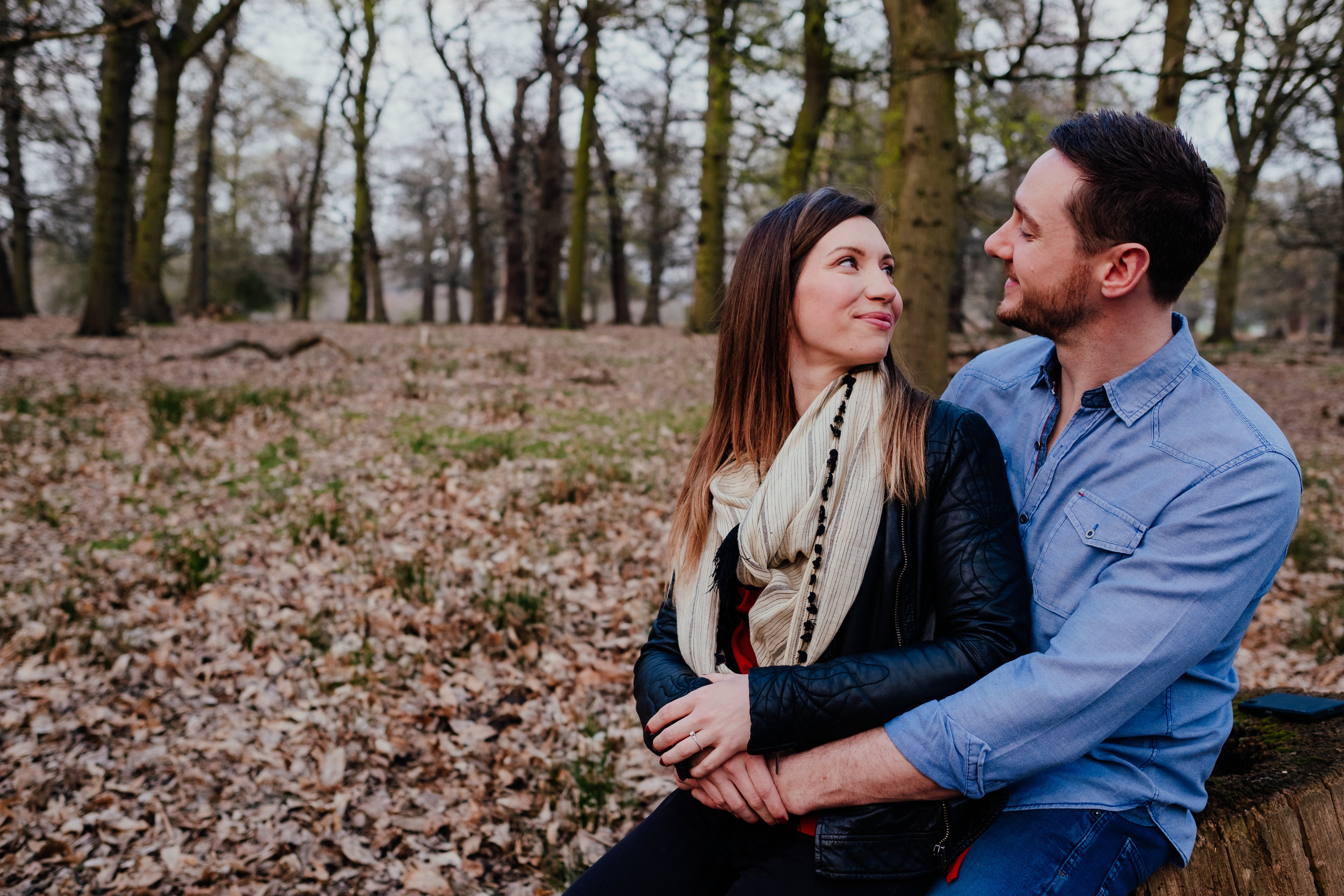 Richmond Park engagement shoot couple looking at each other smiling