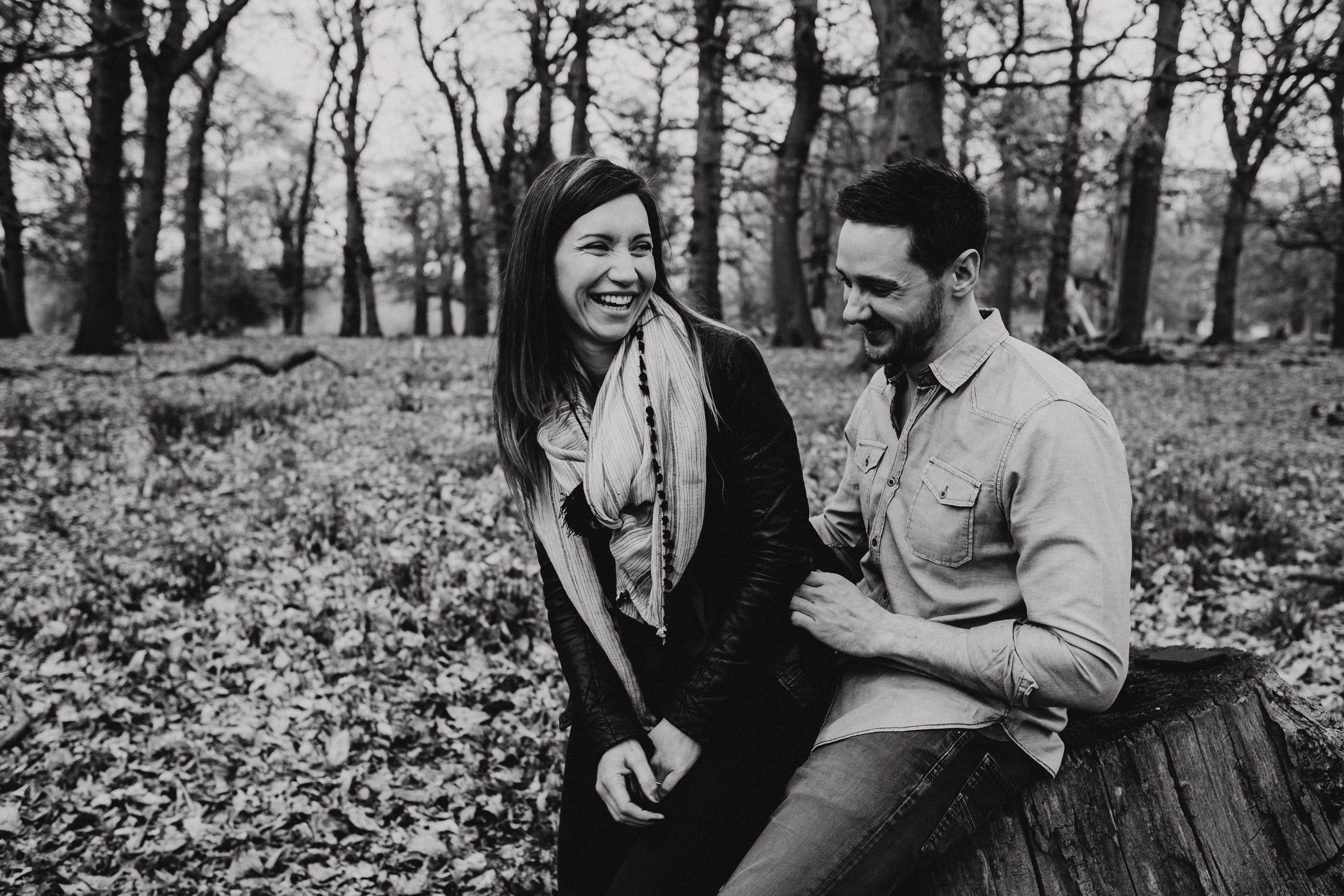 Couple laughing during engagement shoot in Richmond Park