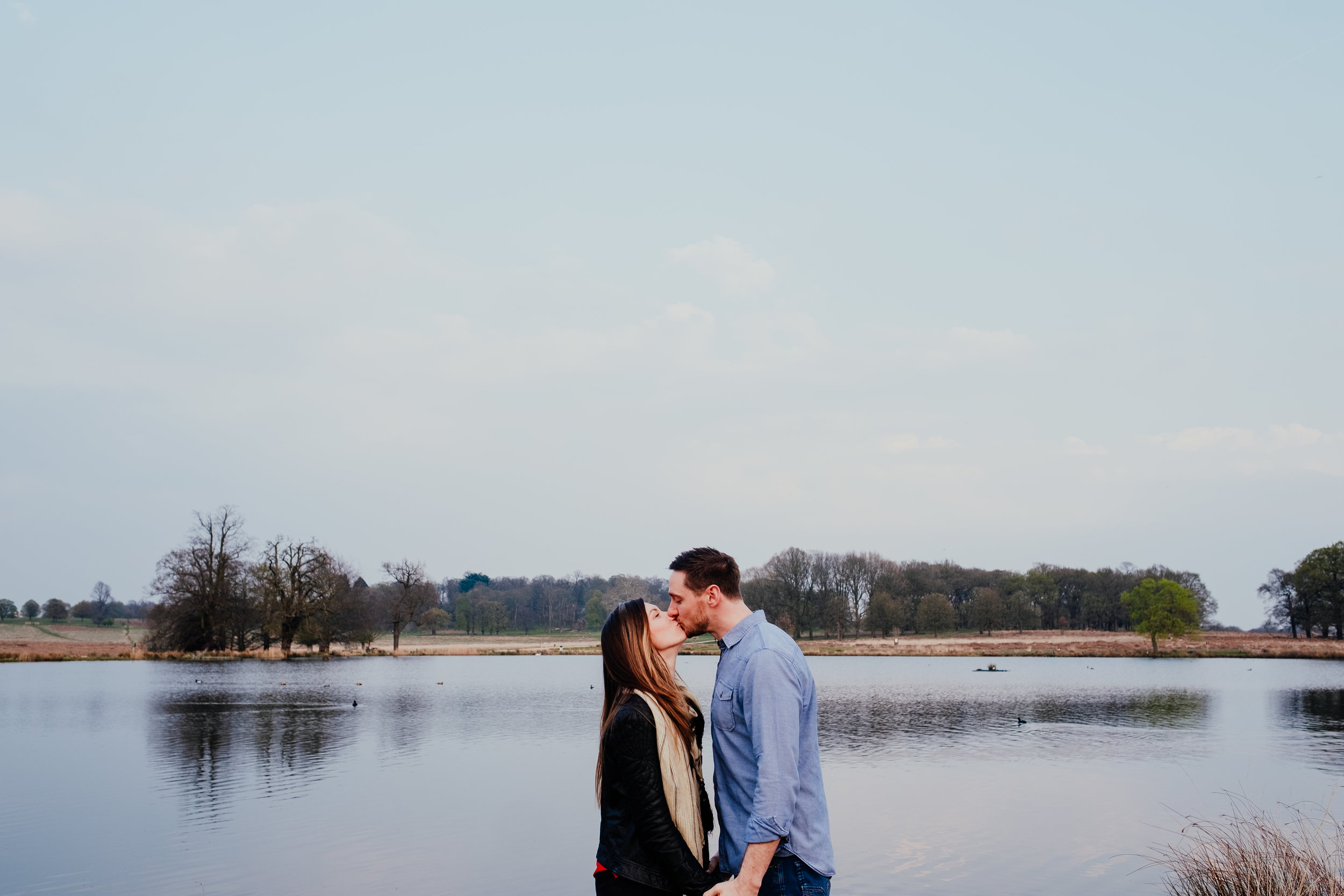 couple kissing during Richmond Park engagement shoot