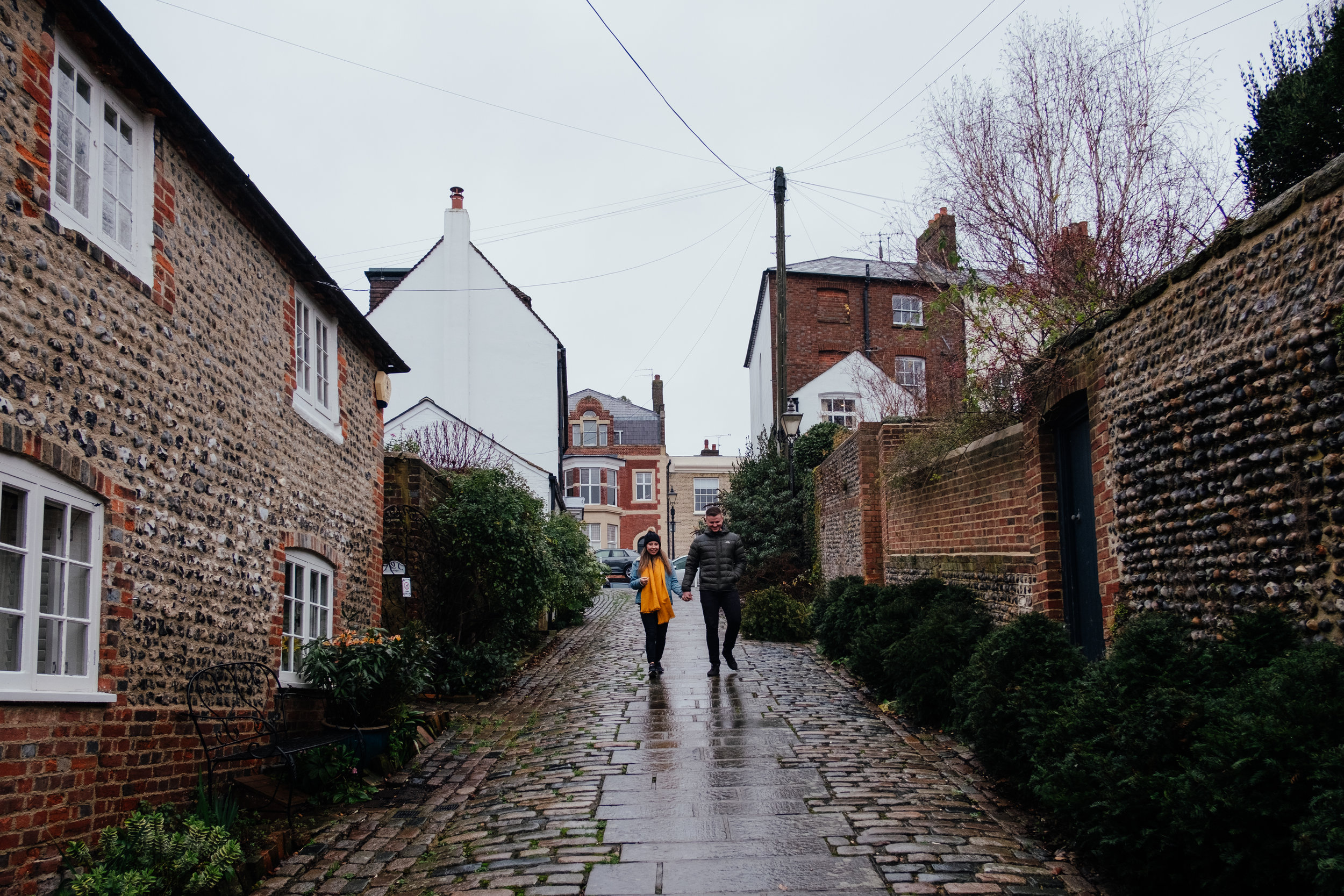 Arundel Engagement shoot | couple walking down cobbled street