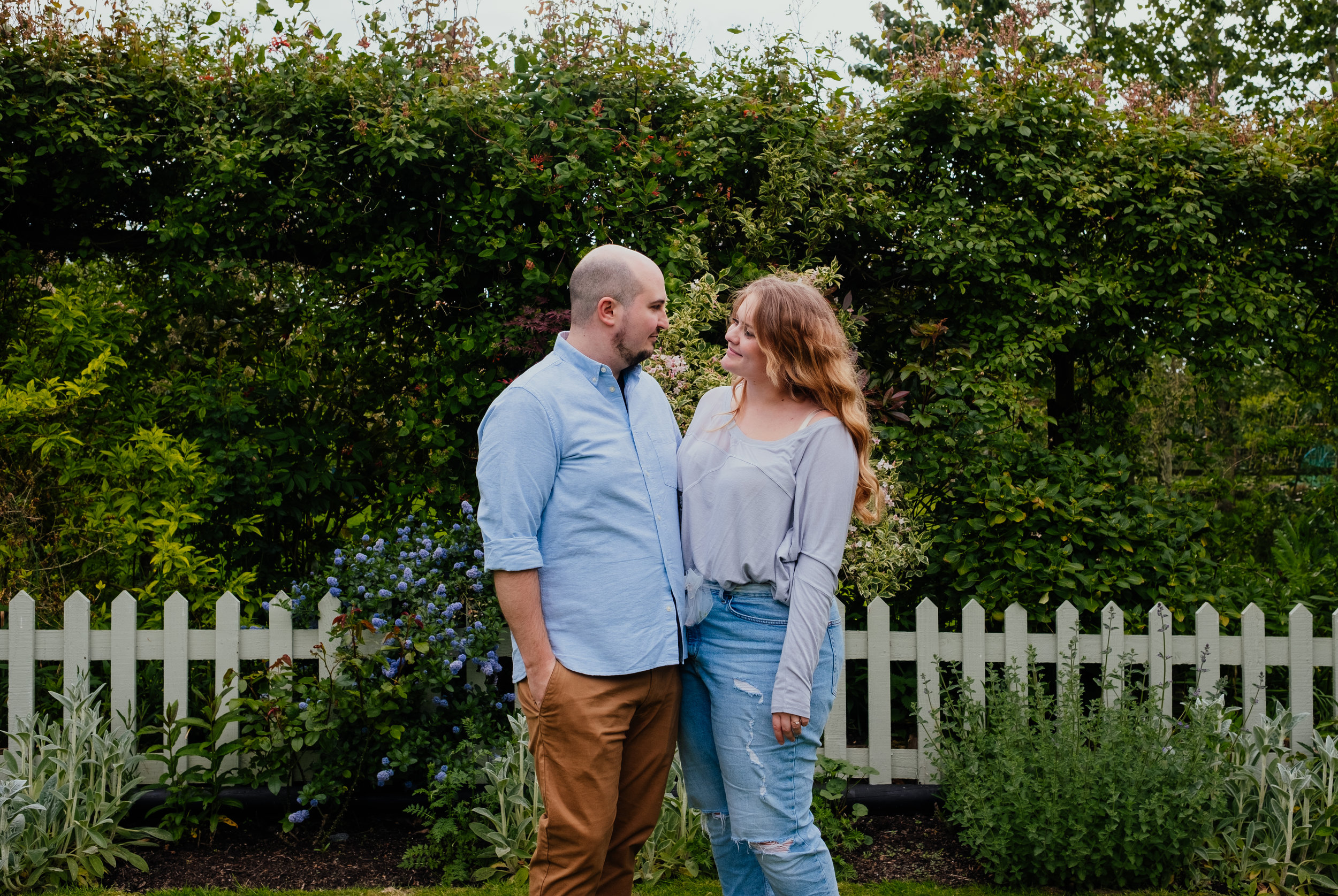 Engaged couple smiling at each other during Rumbolds Farm engagement shoot