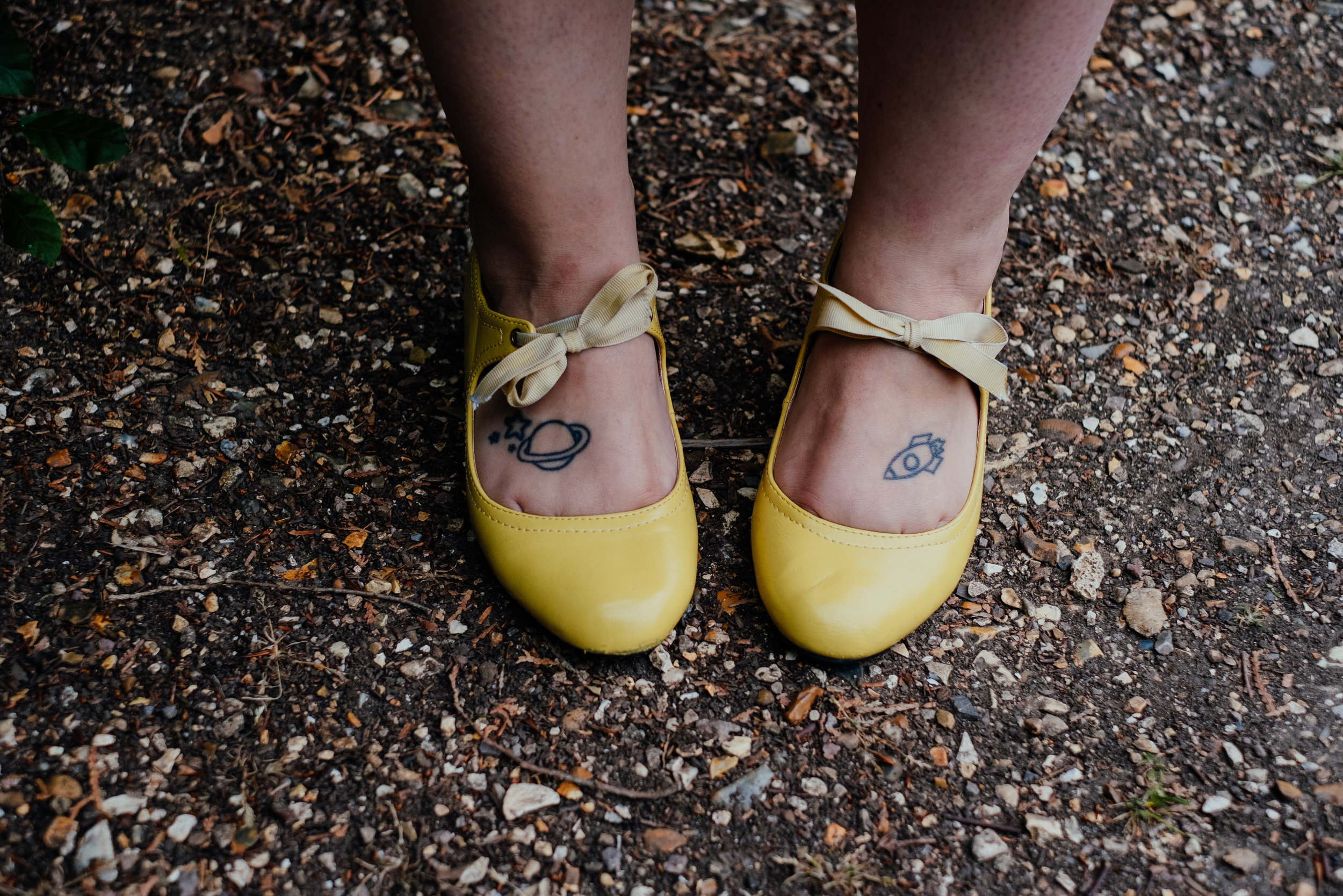 Retro space foot tattoos and yellow 1950s Mary Jane shoes