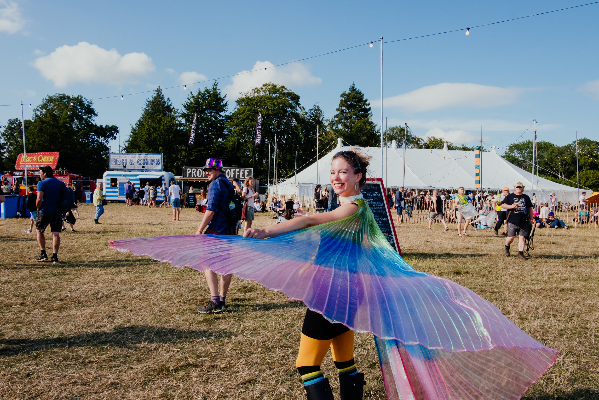 Larmer Tree Festival 2019 colourful capes and dancing