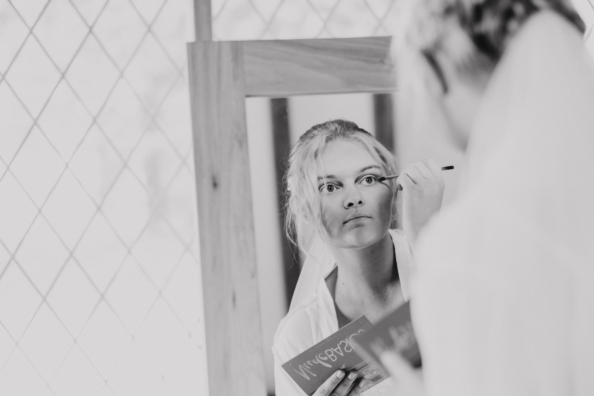 Bride applies her own make up on the morning of her wedding