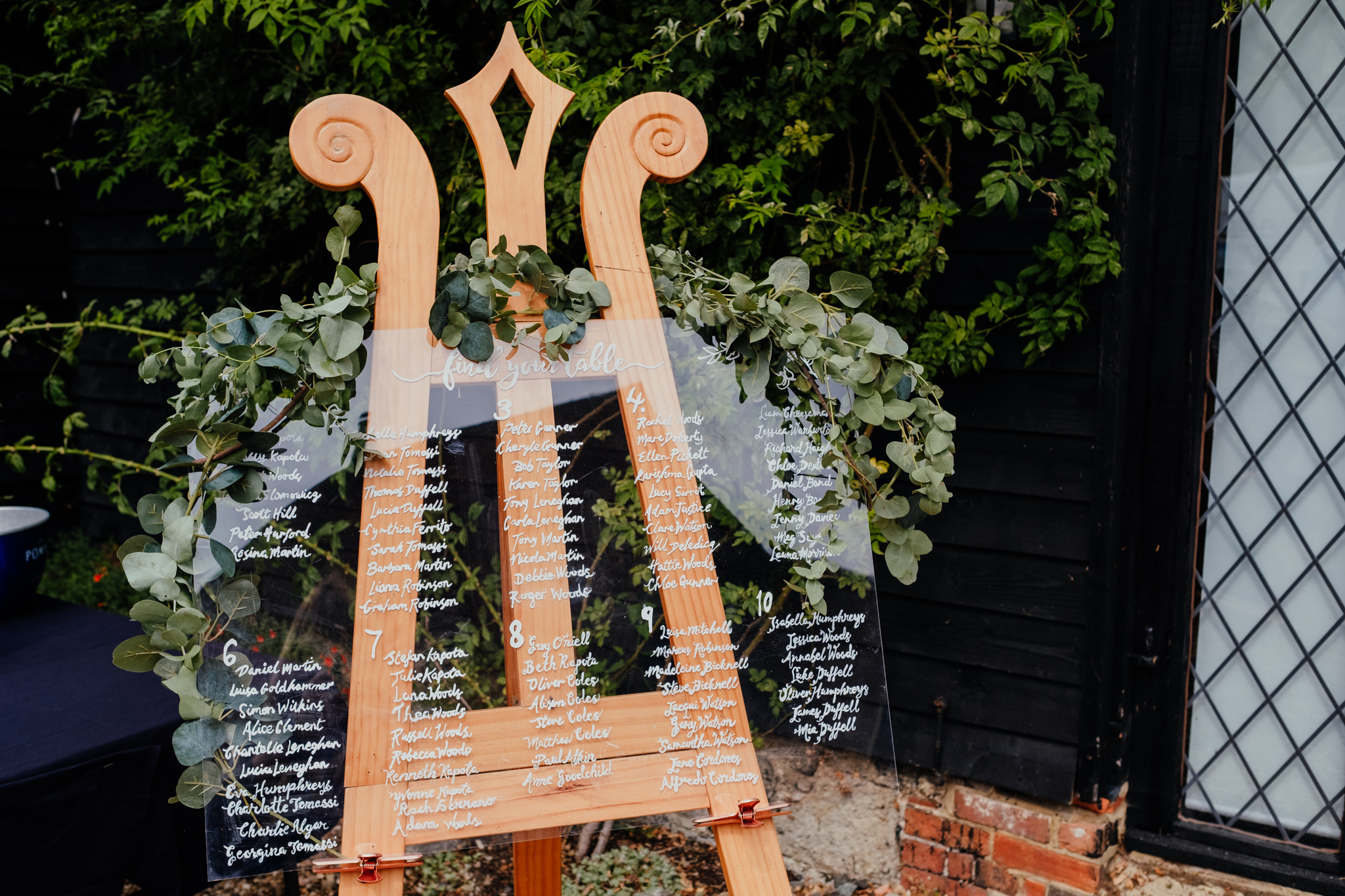 Rumbolds Farm Wedding table plan surrounded by eucalyptus