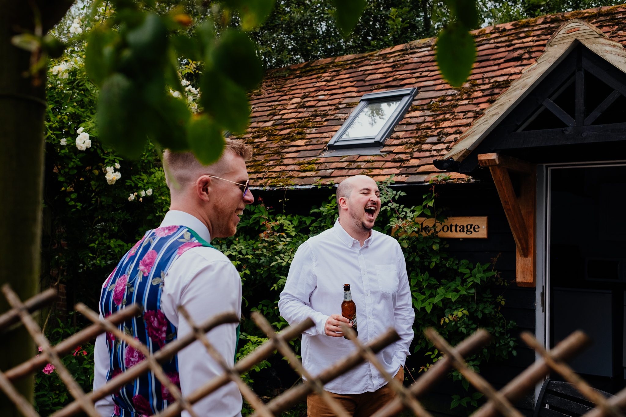 Groom laughs with friends on morning of wedding at Rumbolds Farm