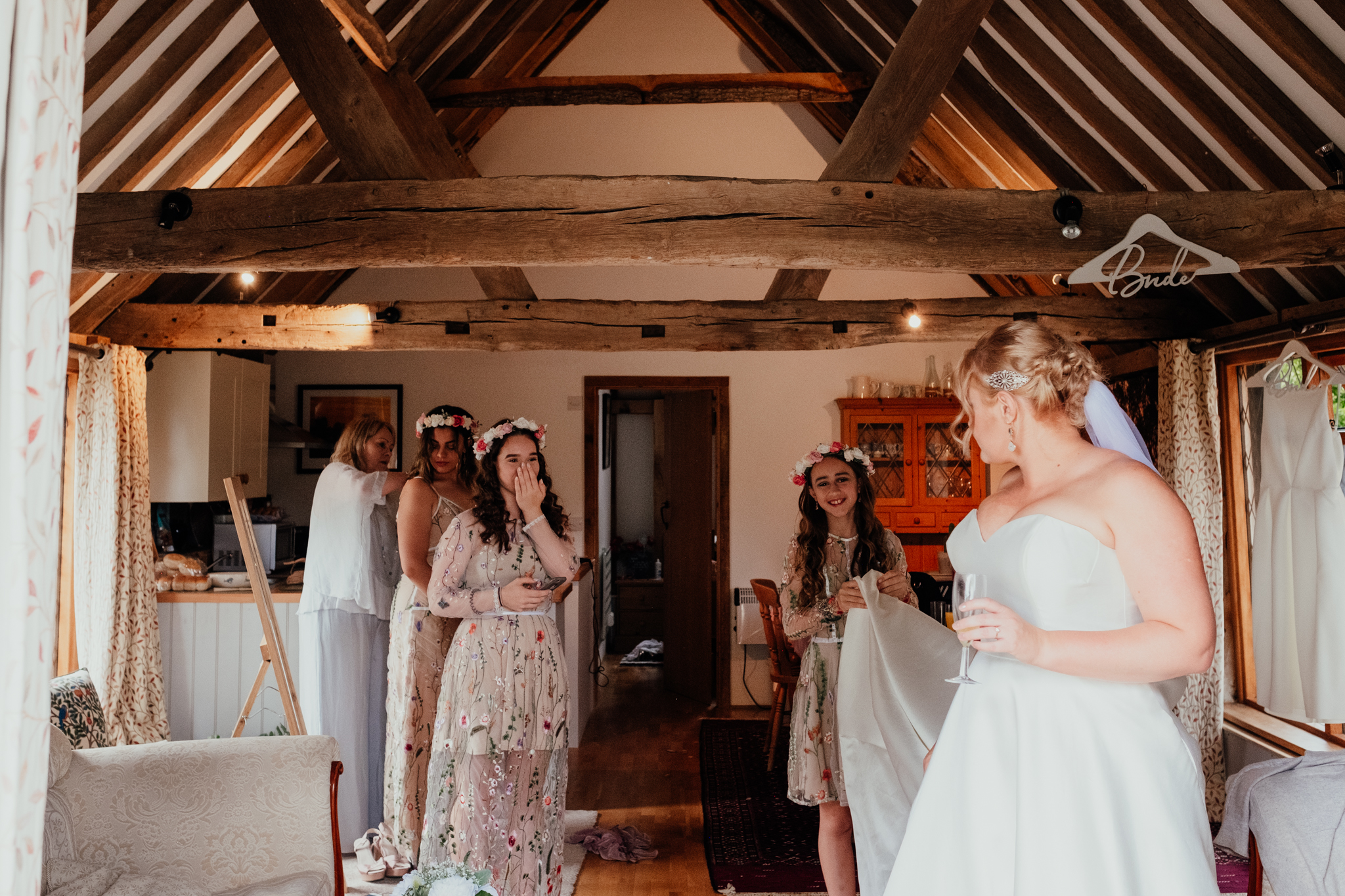Bridesmaids gasp as Bride gets ready