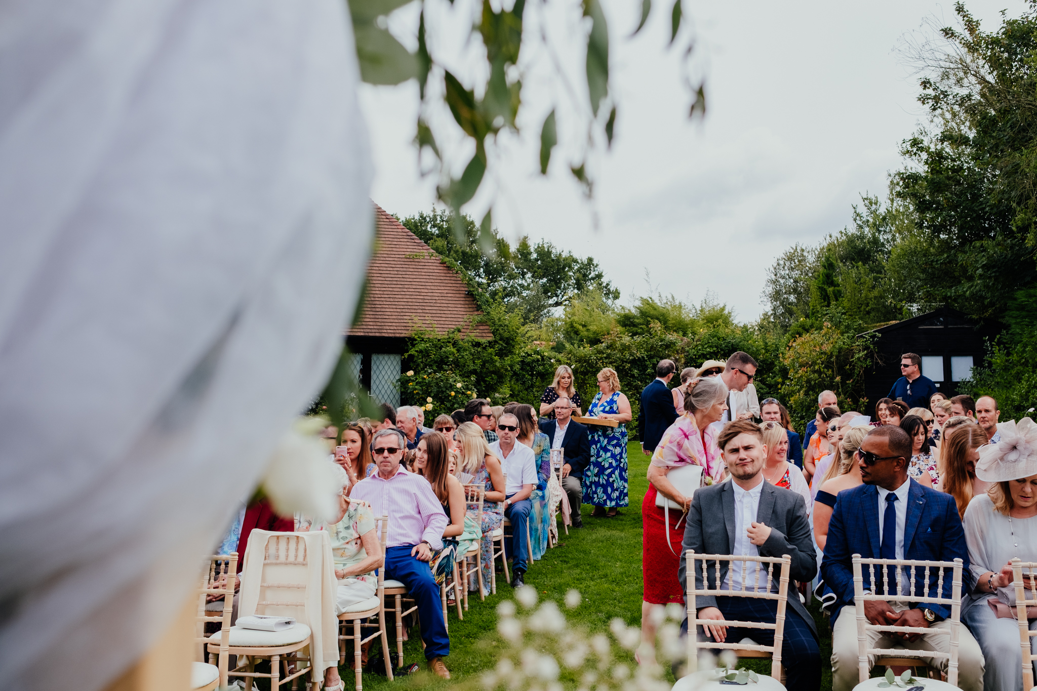 Guests wait for wedding ceremony at Rumbolds Farm