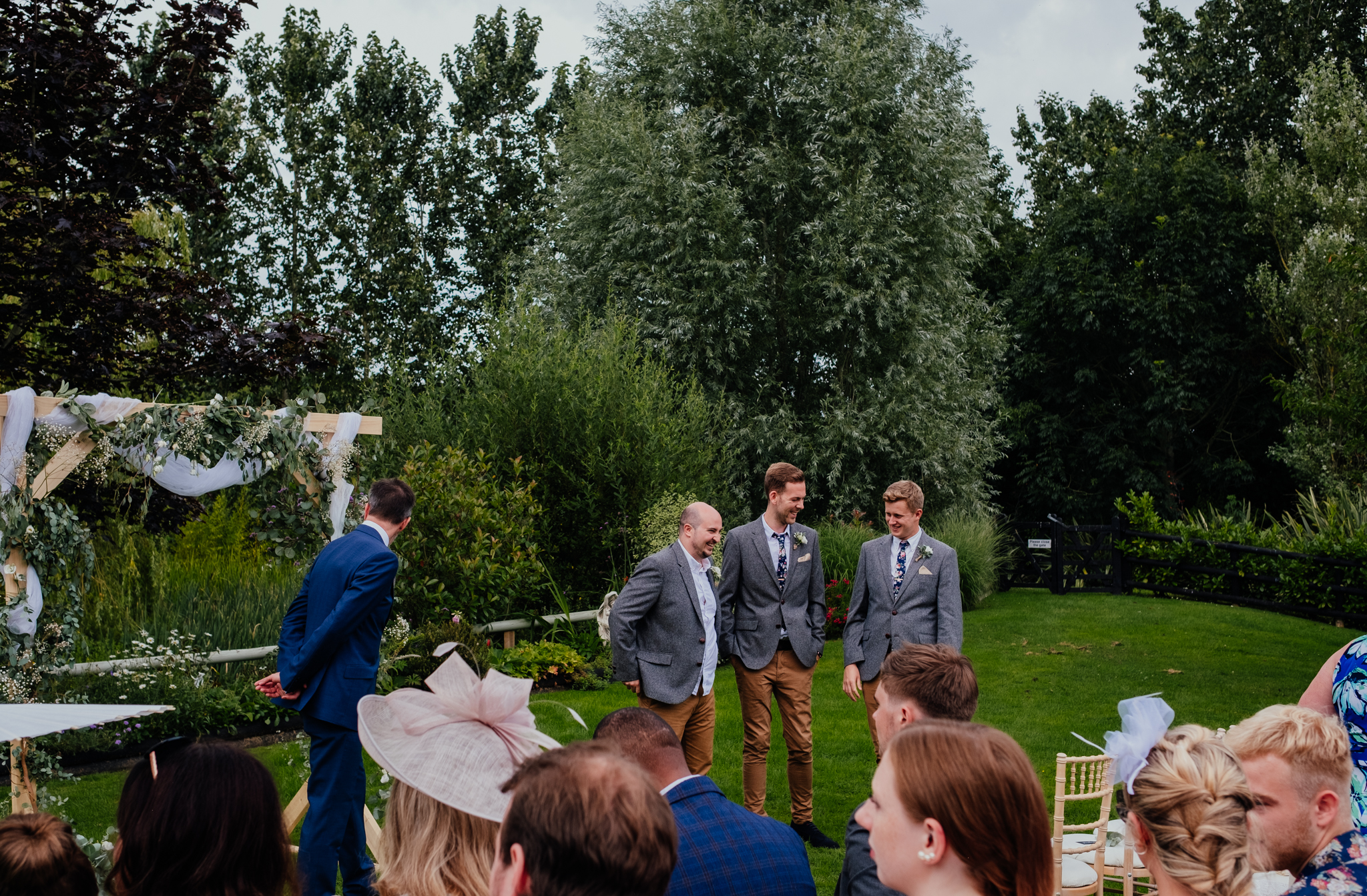 Groom and groomsmen wait for bride at outdoor wedding at Rumbolds Farm