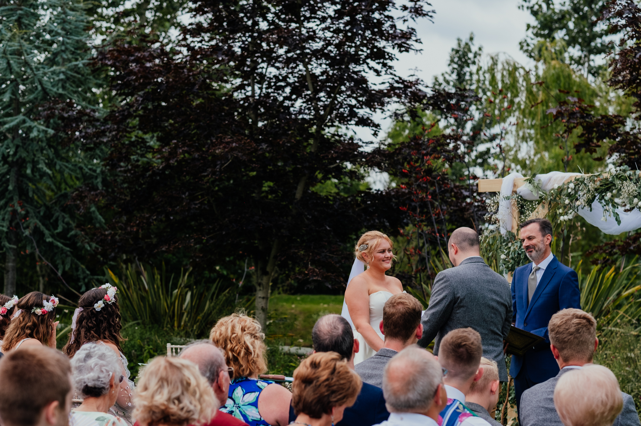 Bride and groom exchanging vows during wedding ceremony at Rumbolds Farm