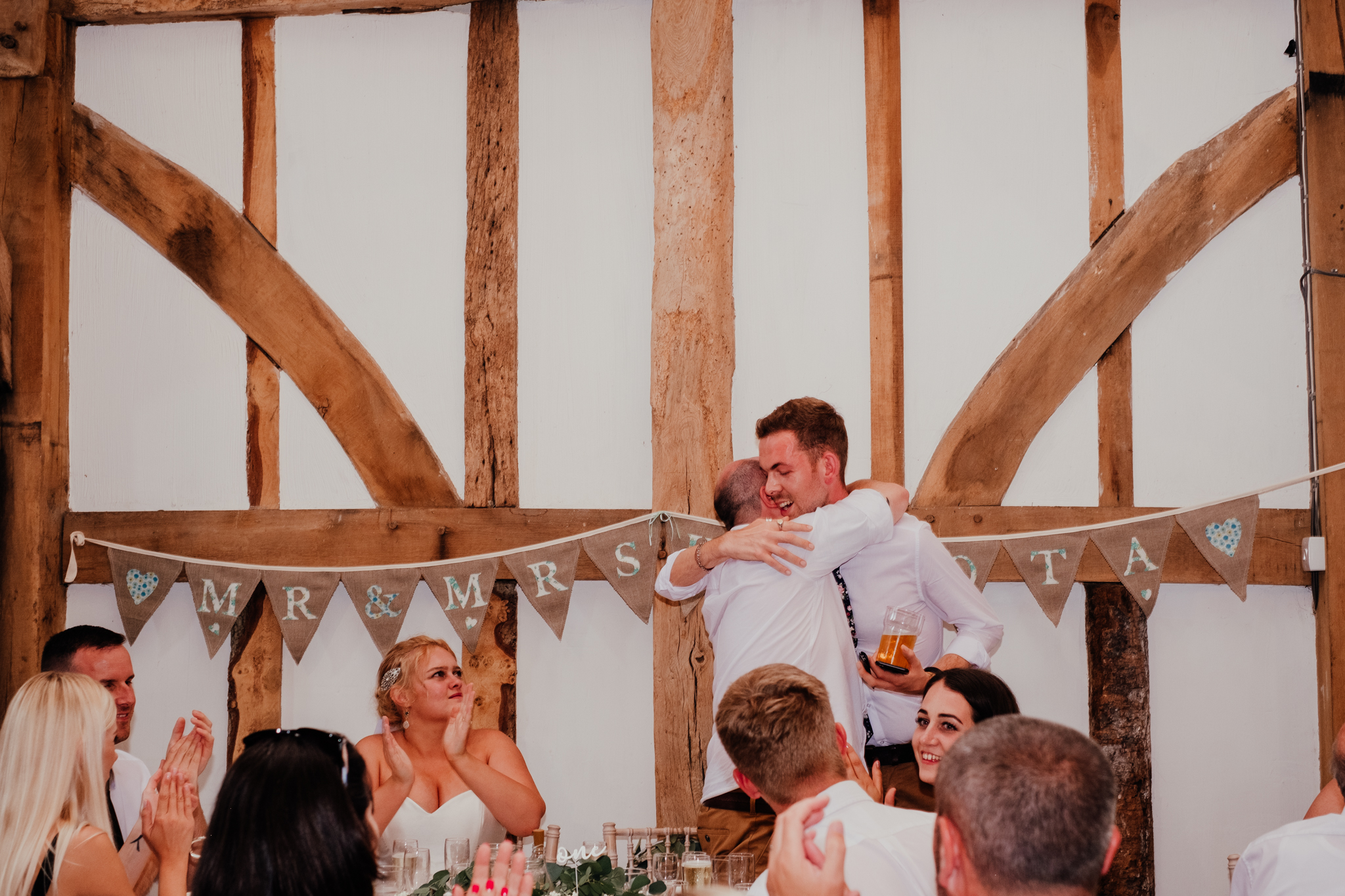 Groom hugging best man during speeches