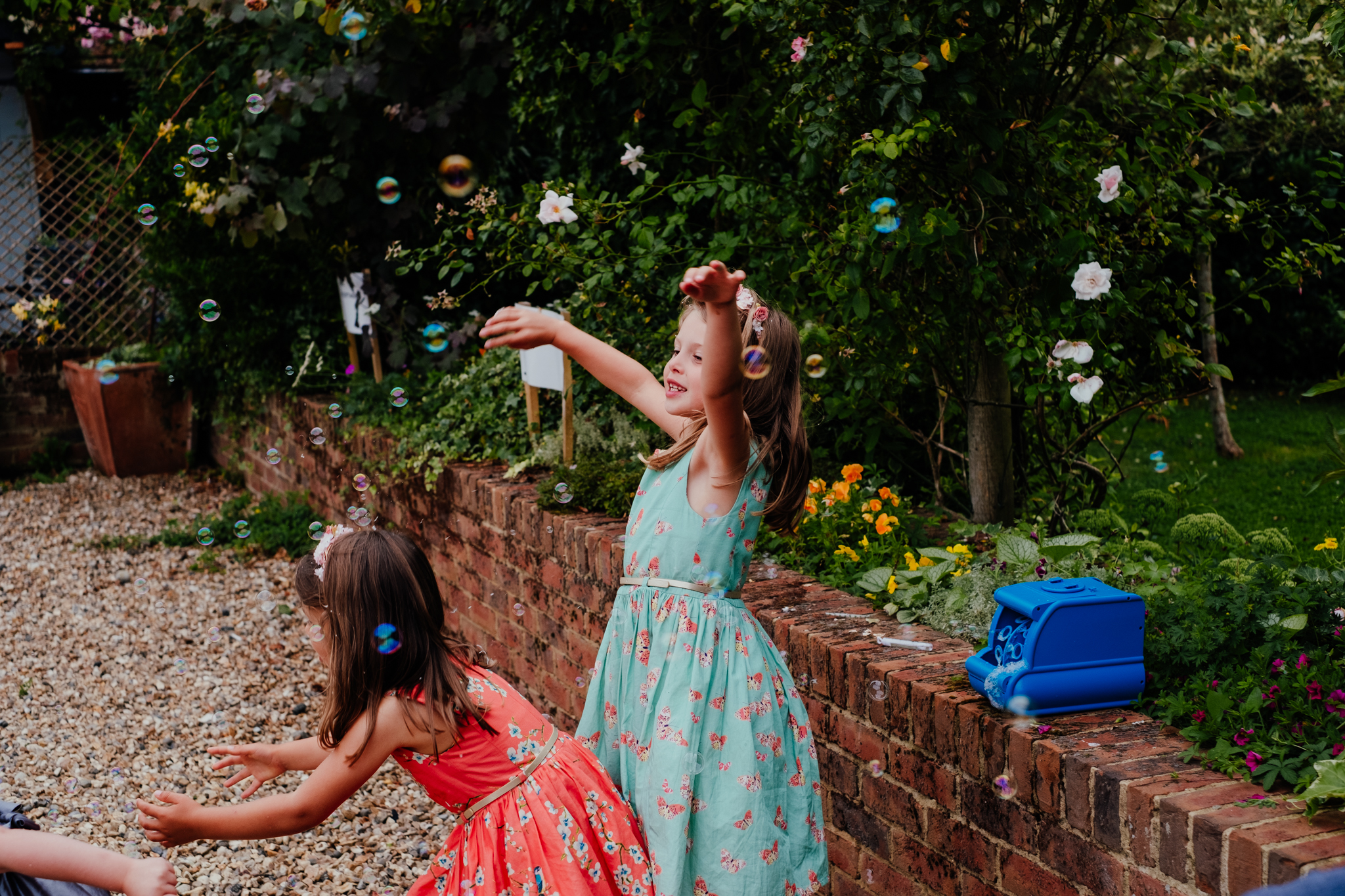 Children playing with bubbles at Rumbolds Farm wedding
