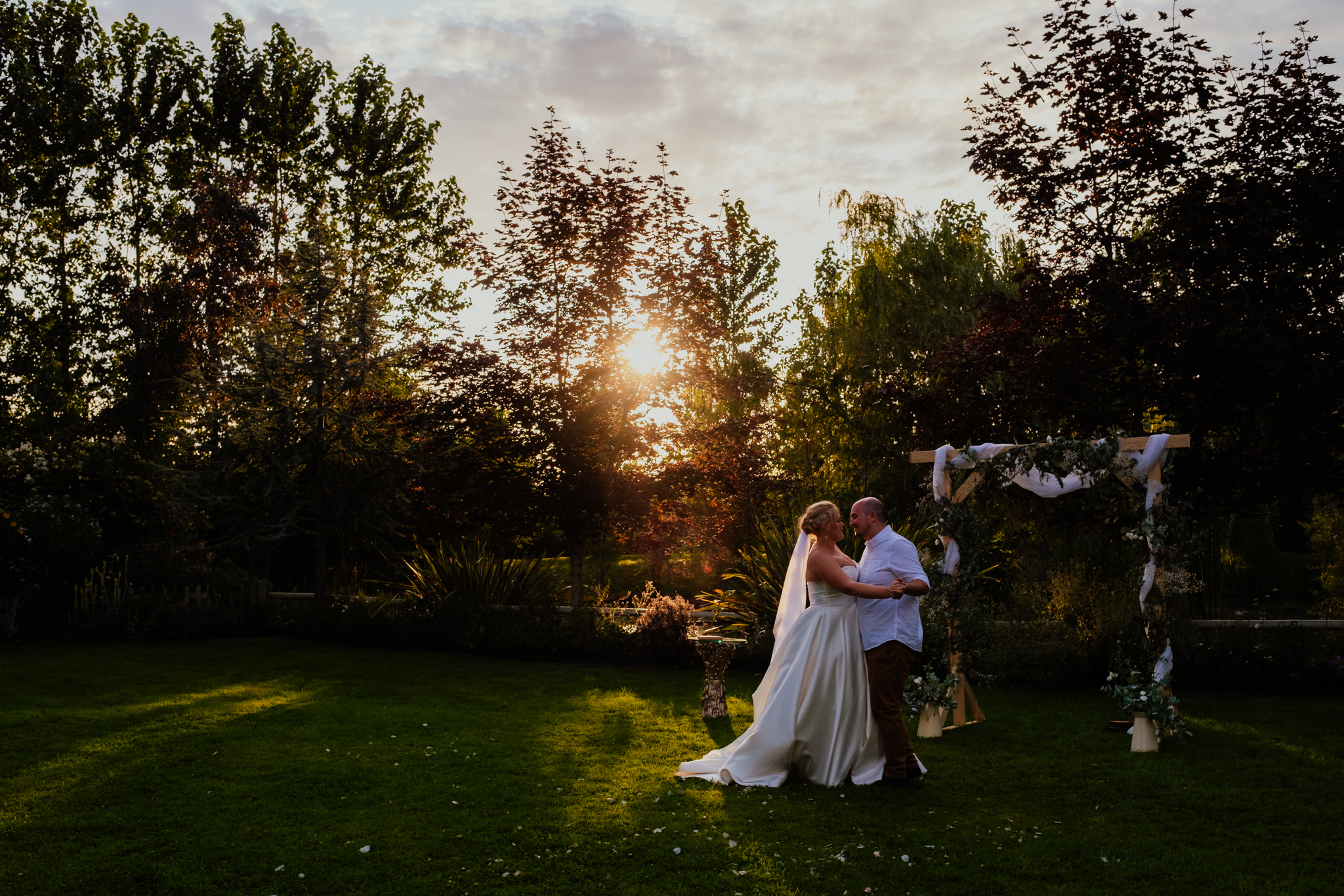 Newlyweds dance under the setting sun at Rumbolds Farm wedding