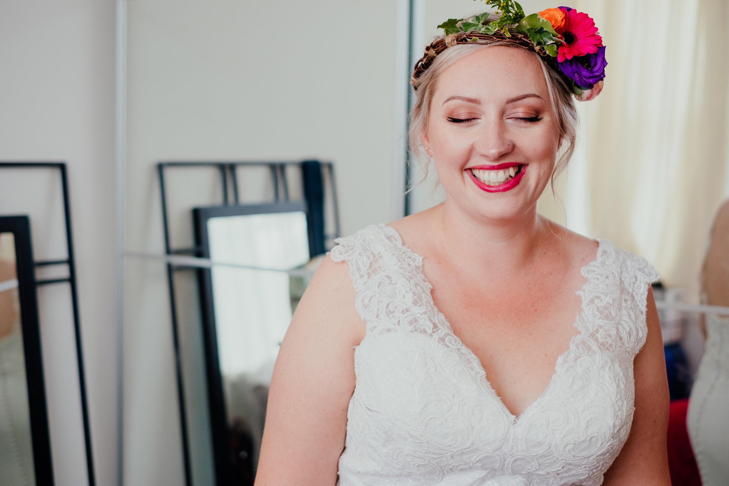 Vegan bride wearing flower crown smiling